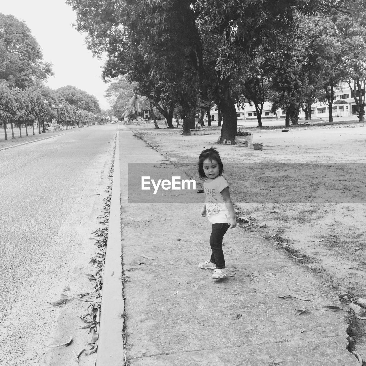 Full Length Of Girl Standing On Road