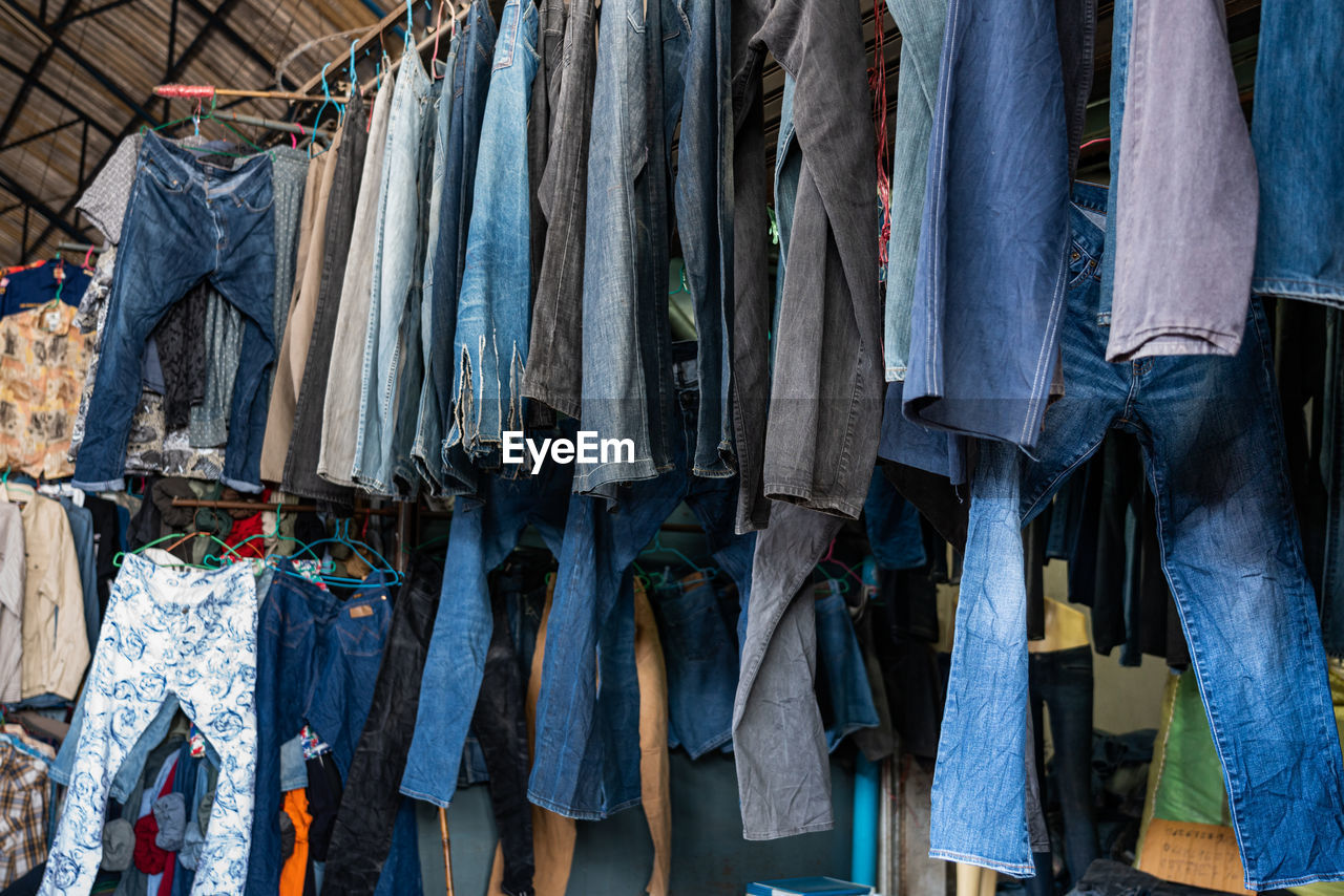 Clothes hanging in row at market