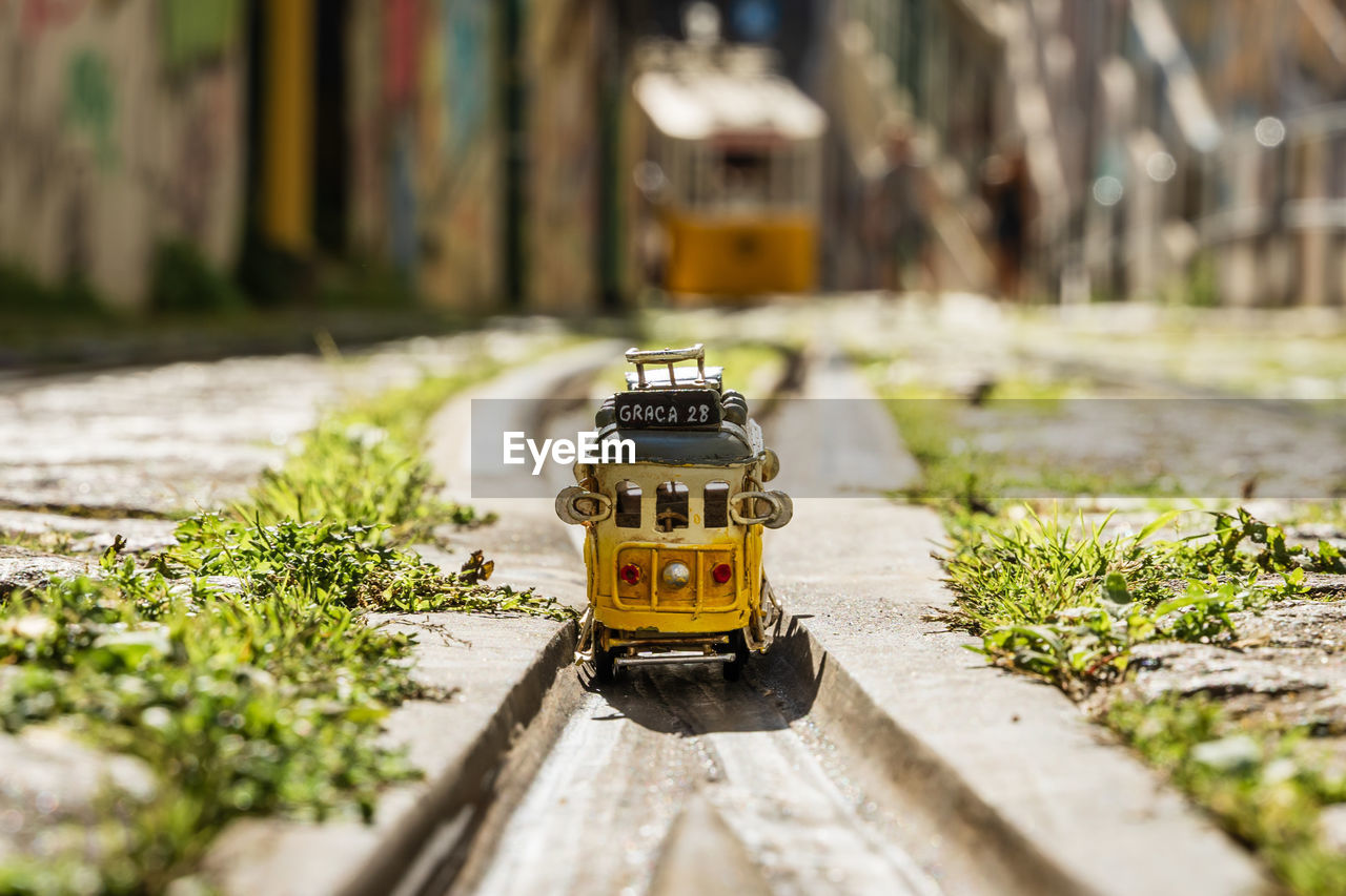 SMALL TOY CAR ON STREET
