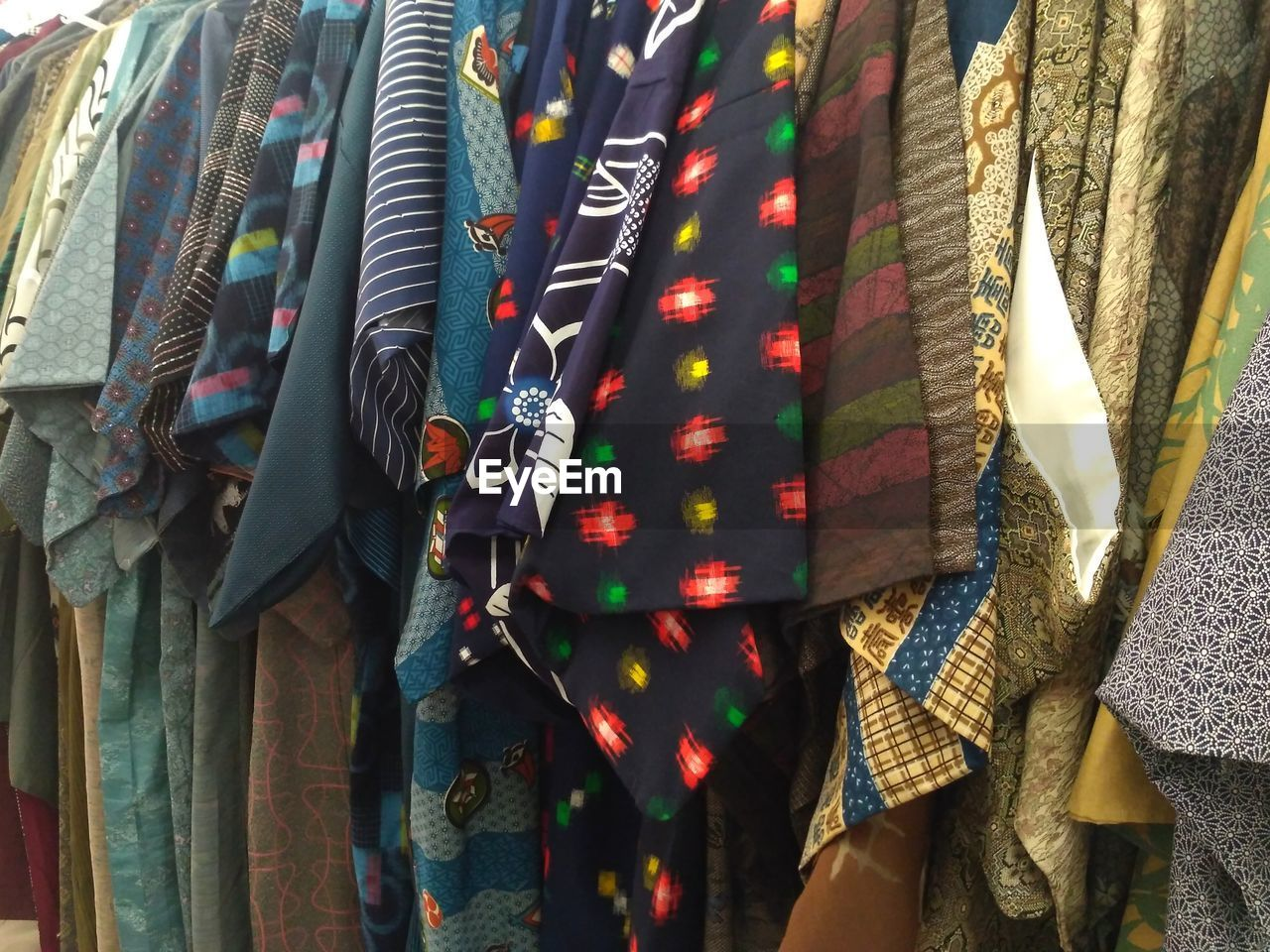 Full frame shot of multi colored clothing hanging on display for sale