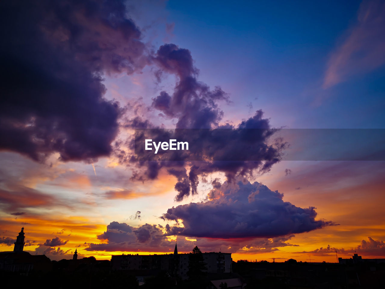 sky, sunset, cloud - sky, beauty in nature, silhouette, nature, scenics - nature, orange color, building exterior, architecture, built structure, no people, outdoors, dramatic sky, environment, smoke - physical structure, building, idyllic, low angle view, power, pollution, power in nature