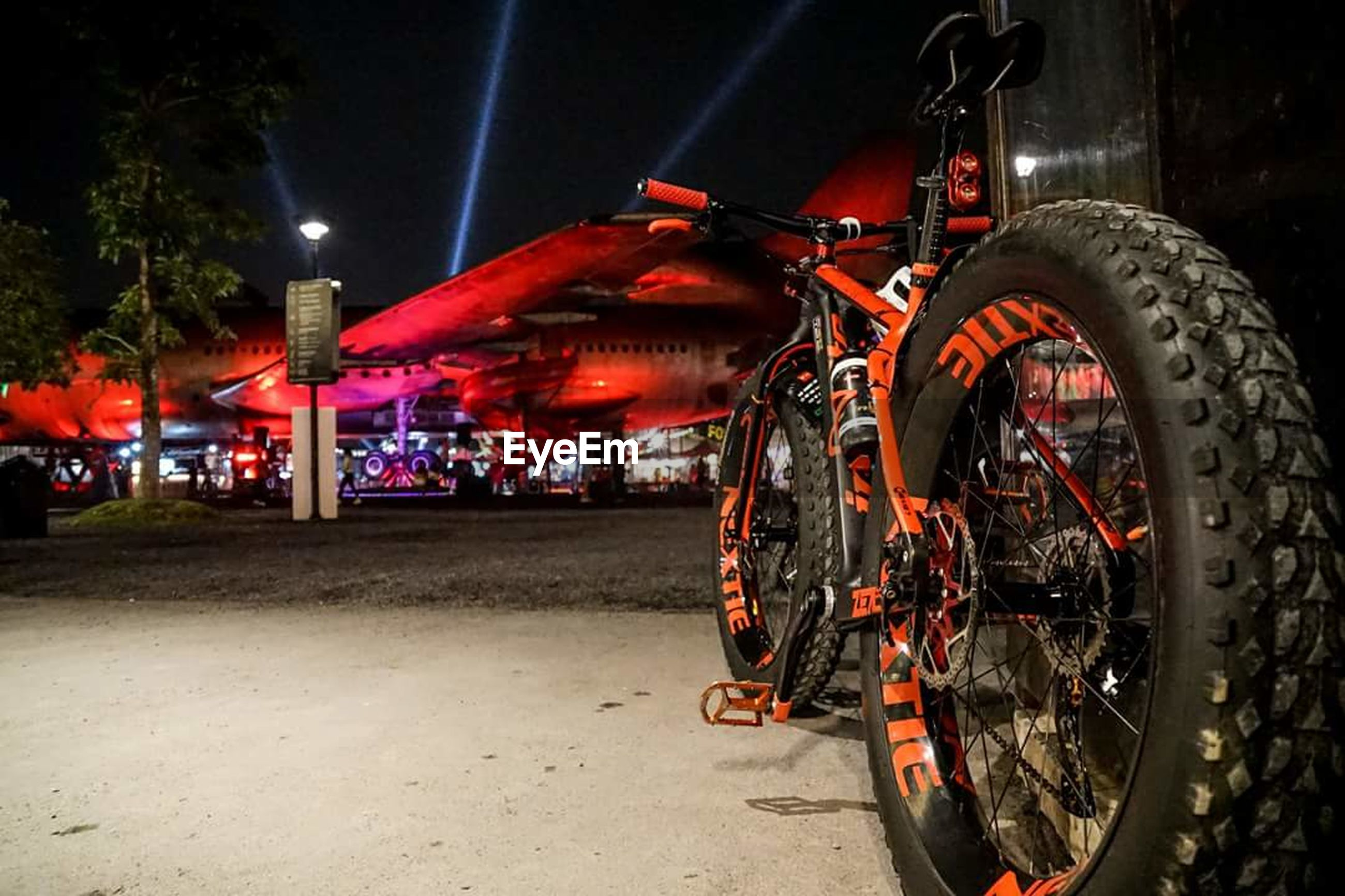 illuminated, night, transportation, outdoors, no people, land vehicle, red, tire, building exterior, sky