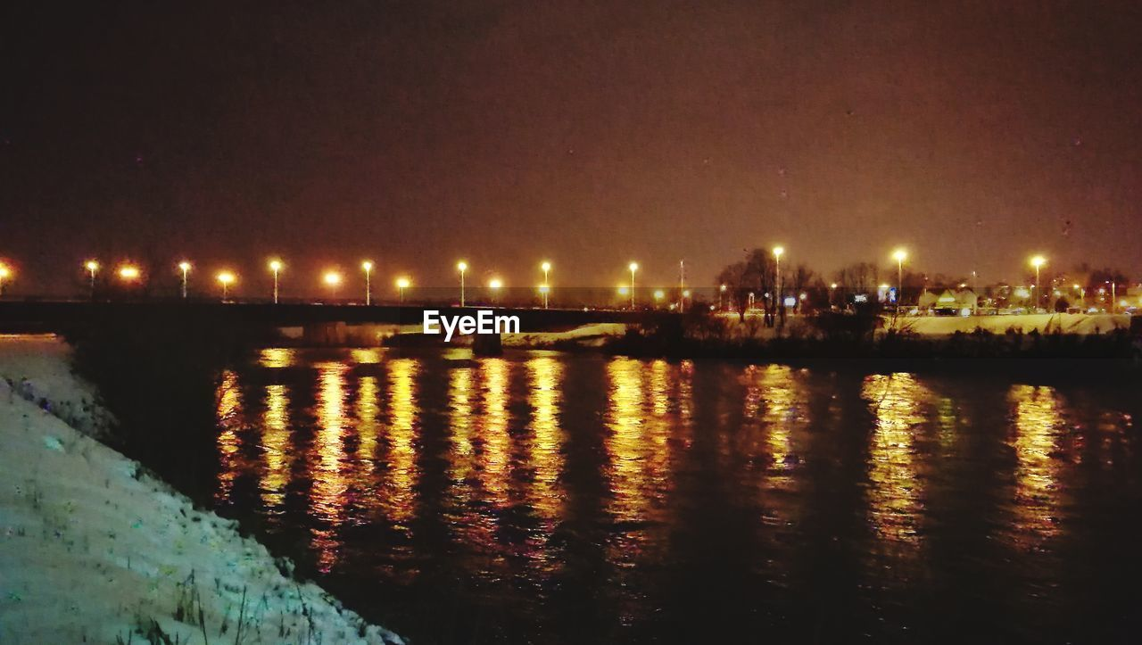 illuminated, night, architecture, built structure, water, river, reflection, building exterior, bridge - man made structure, city, no people, outdoors, sky, cityscape, nature