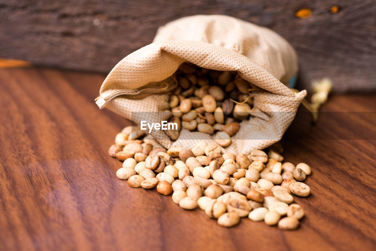 food and drink, still life, food, sack, table, wood - material, raw food, healthy eating, freshness, indoors, wellbeing, no people, high angle view, vegetable, bean, close-up, bag, brown, burlap, large group of objects, legume family, jute, vegetarian food