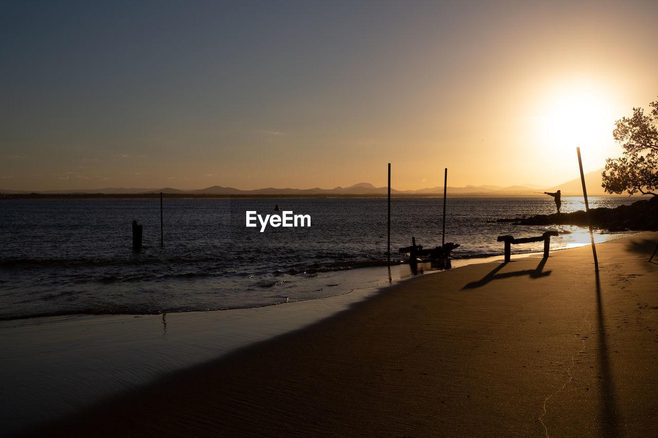 water, sky, sea, sunset, beauty in nature, scenics - nature, beach, horizon, horizon over water, land, silhouette, nature, tranquility, sun, sunlight, tranquil scene, real people, sand, idyllic, outdoors