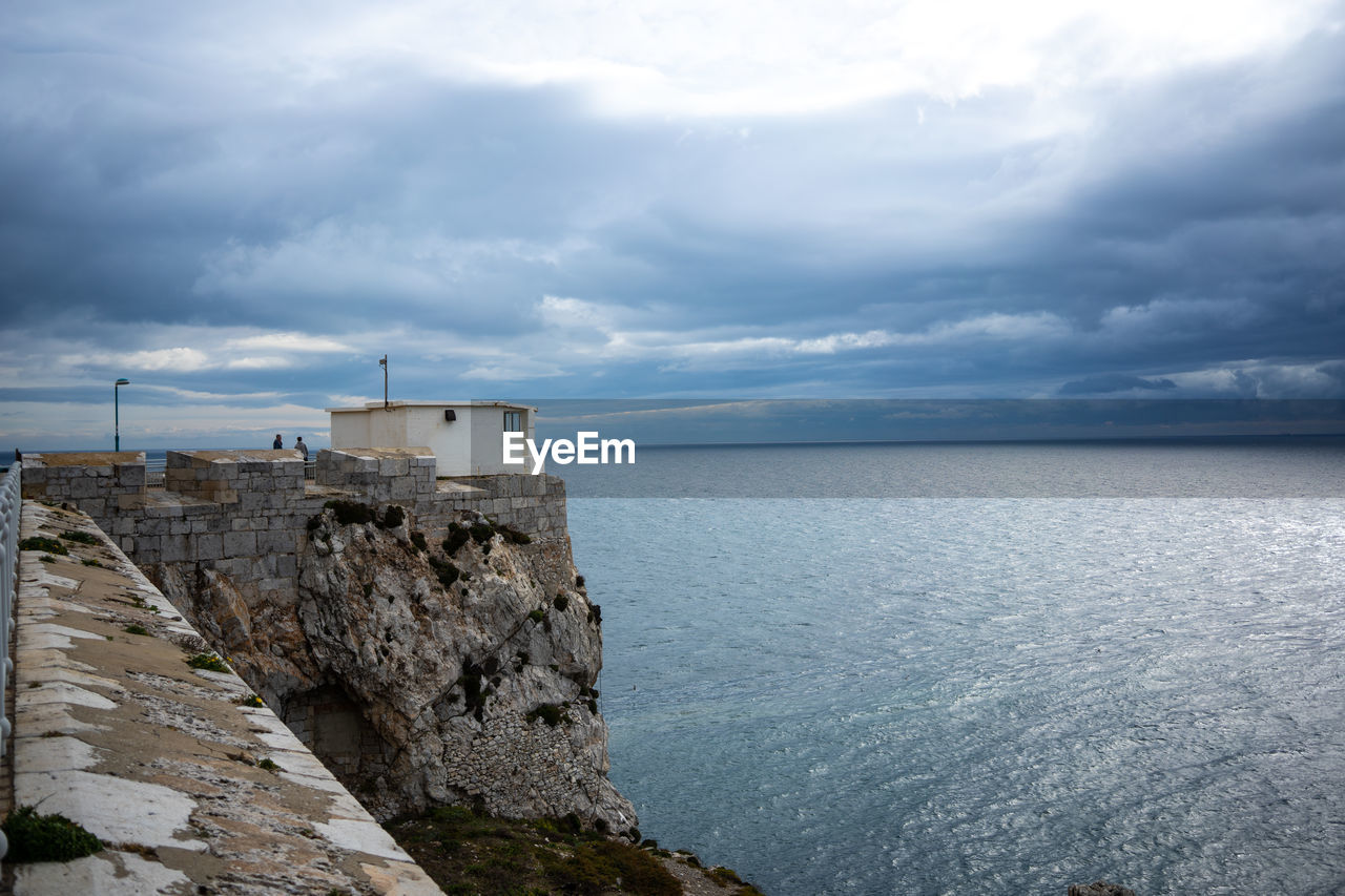 cloud - sky, sky, sea, water, scenics - nature, architecture, built structure, nature, horizon over water, horizon, rock, beauty in nature, tranquil scene, no people, solid, building exterior, day, tranquility, outdoors