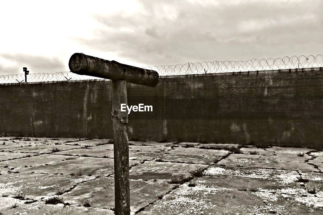 history, day, sky, outdoors, built structure, no people, weapon, canon