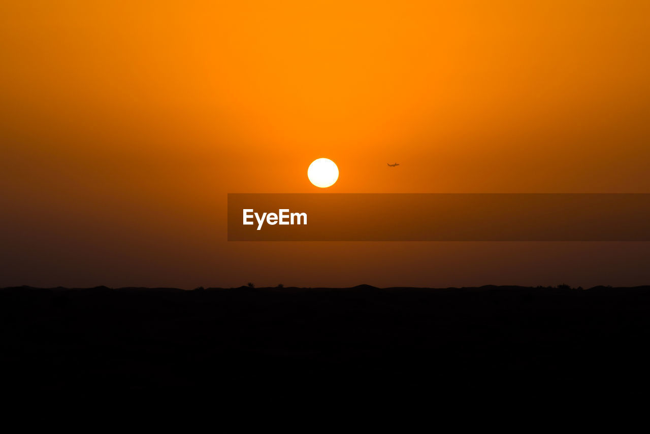 sunset, orange color, moon, sun, beauty in nature, scenics, nature, tranquil scene, silhouette, copy space, sky, no people, tranquility, outdoors, idyllic, landscape, astronomy