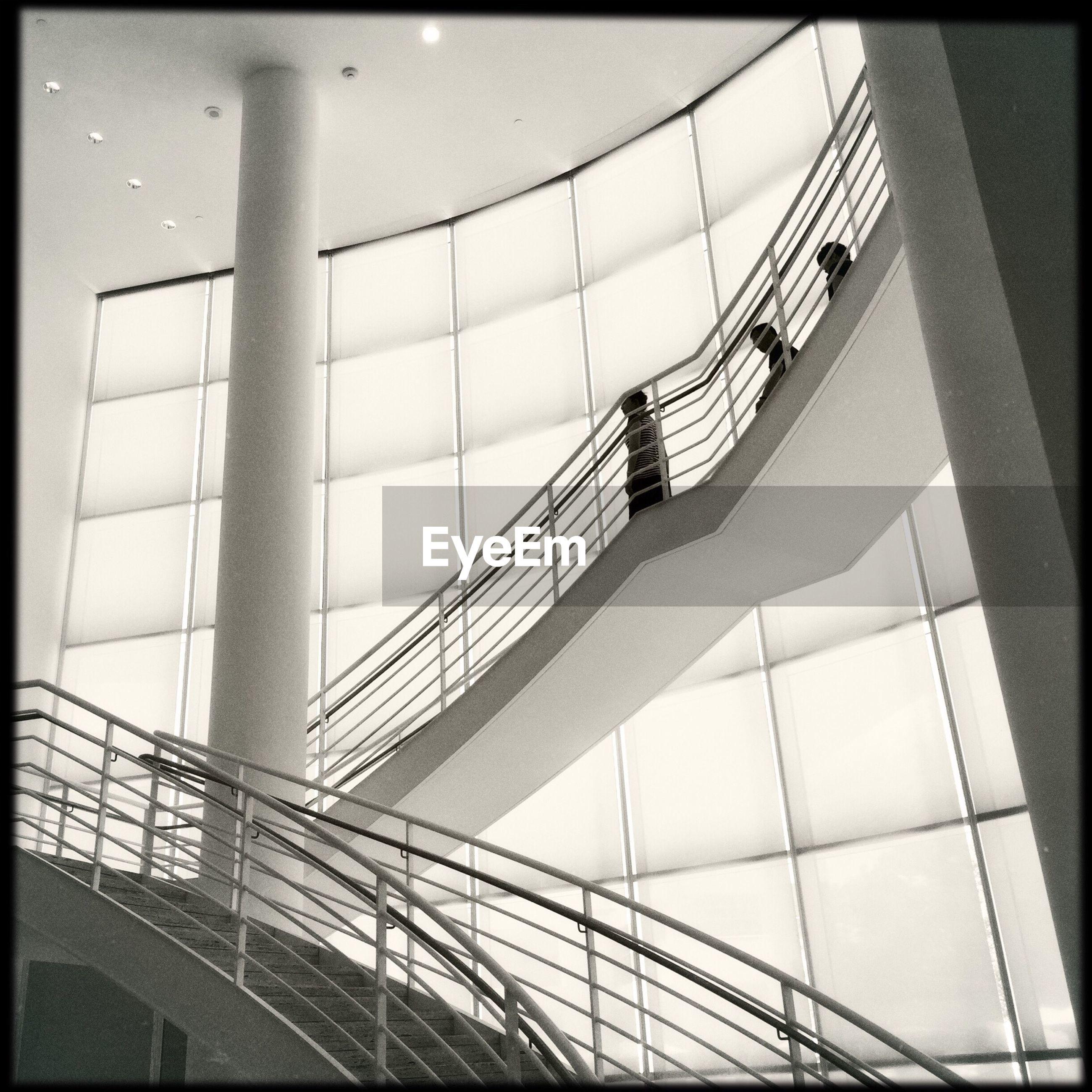 low angle view, railing, indoors, transfer print, built structure, architecture, auto post production filter, steps, escalator, modern, staircase, steps and staircases, metal, transportation, day, no people, glass - material, high angle view, pattern, sky