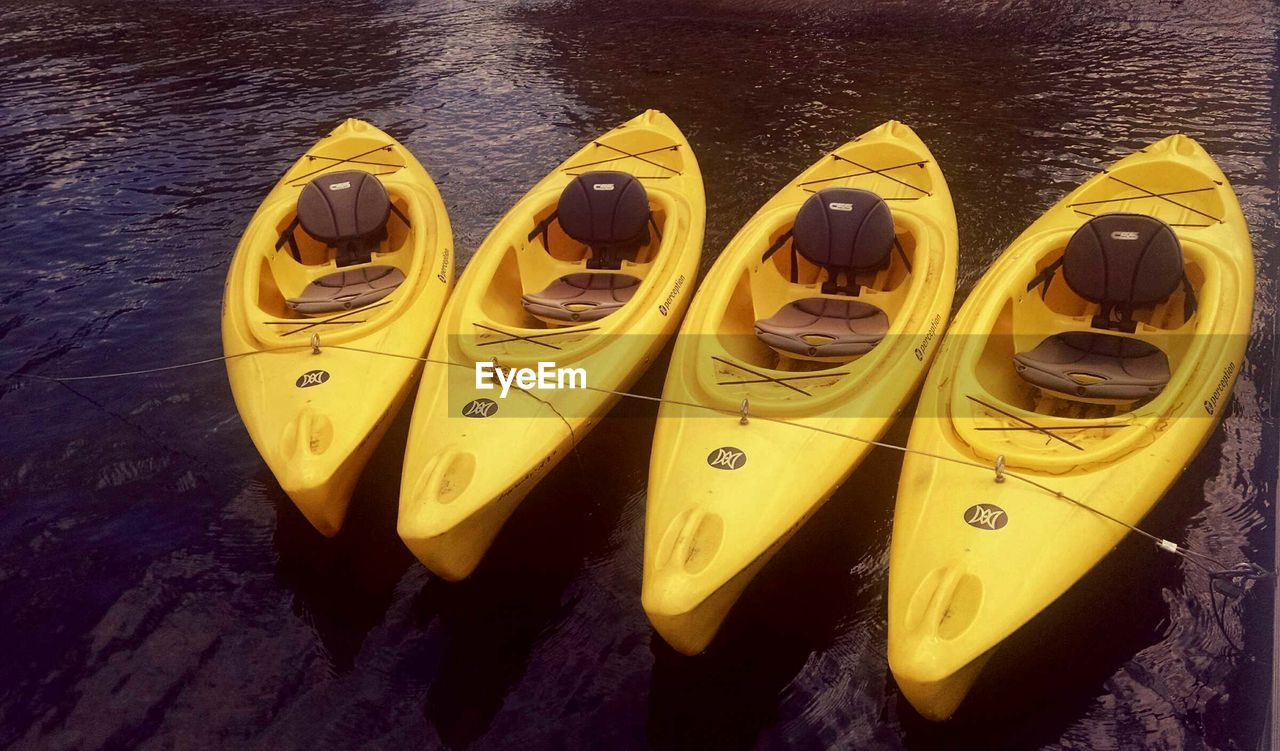 in a row, yellow, no people, high angle view, transportation, nautical vessel, outdoors, day, moored, pedal boat, close-up