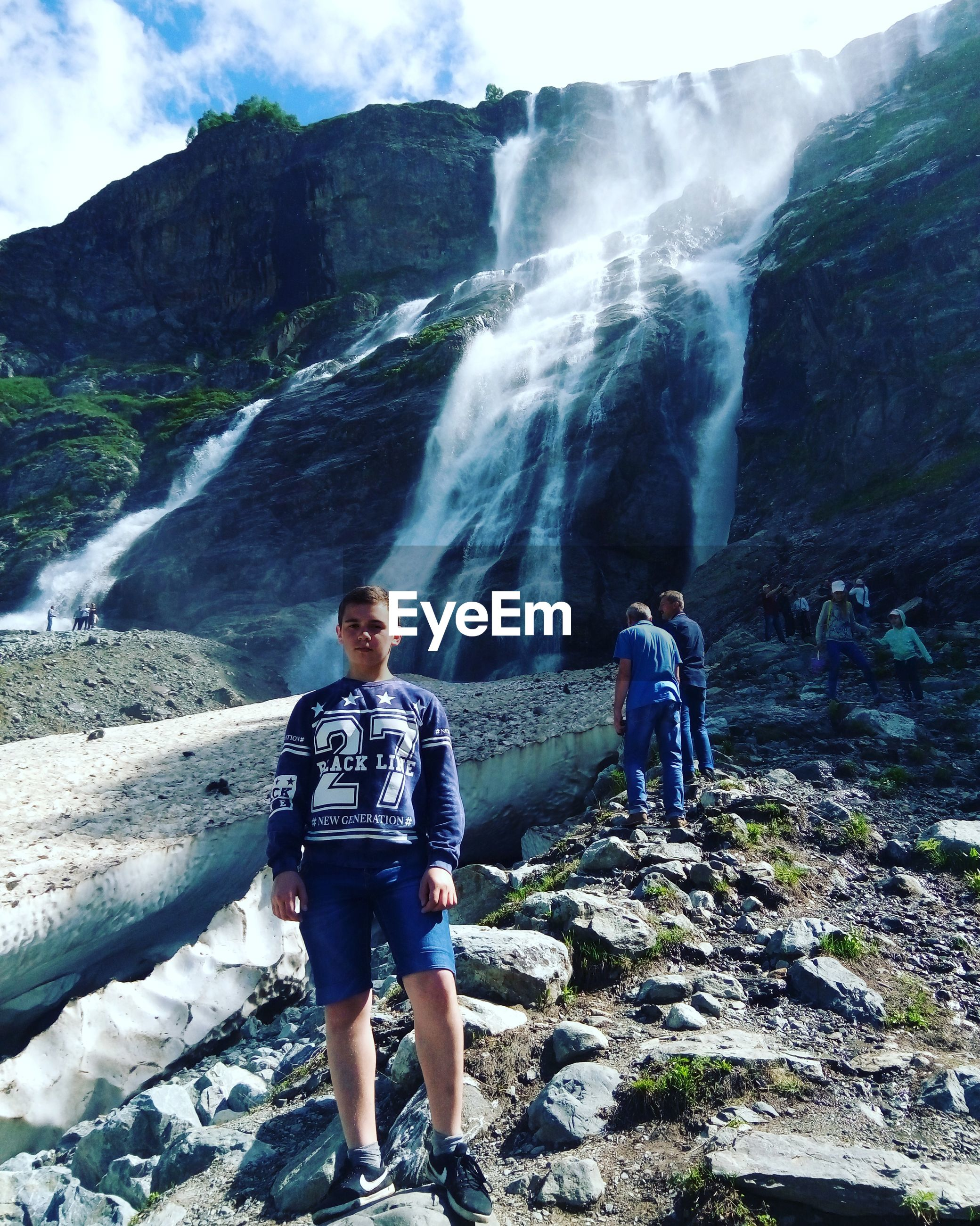lifestyles, leisure activity, full length, mountain, casual clothing, rock - object, backpack, vacations, adventure, motion, nature, rock formation, beauty in nature, tourist, enjoyment, sky, warm clothing, day, outdoors, tourism, fun, scenics, rock