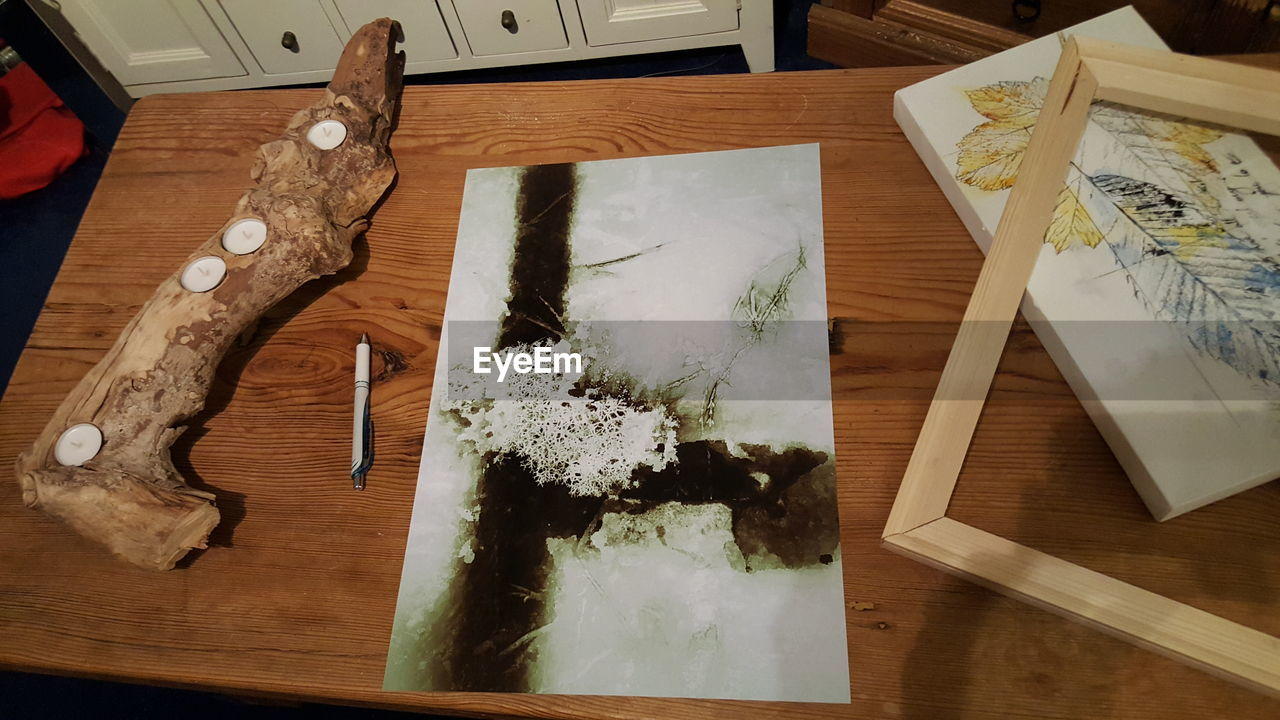 table, high angle view, indoors, wood - material, paper, no people, close-up, day