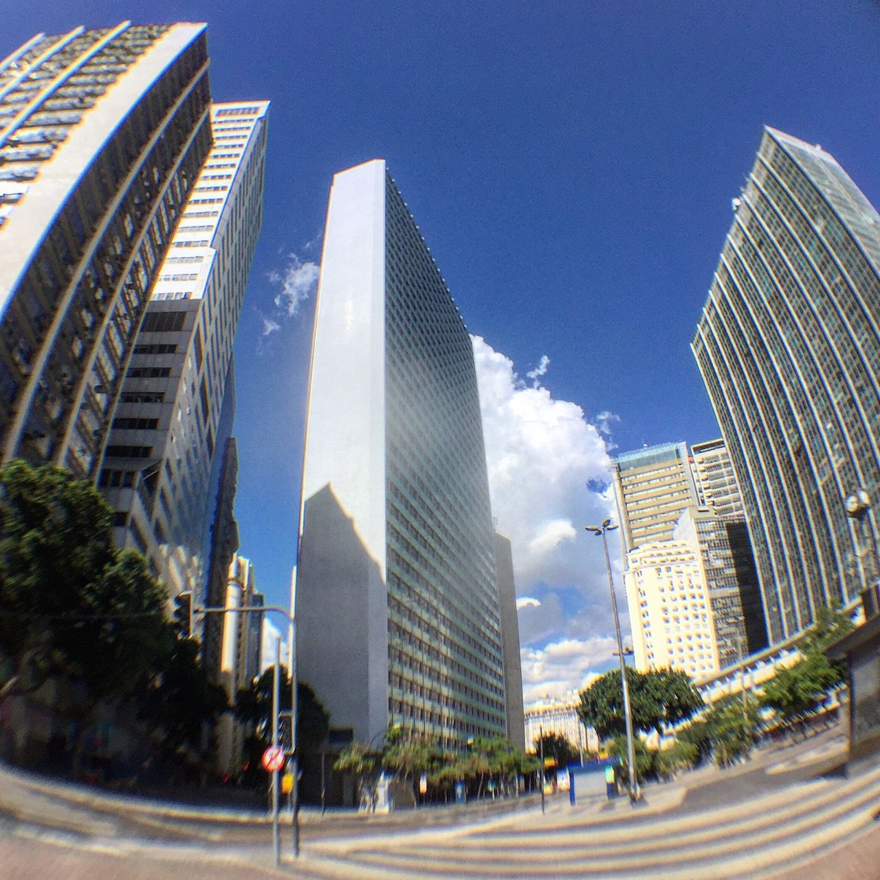 architecture, skyscraper, building exterior, city, built structure, modern, outdoors, city life, day, real people, sky, tree, travel destinations, clear sky, cityscape