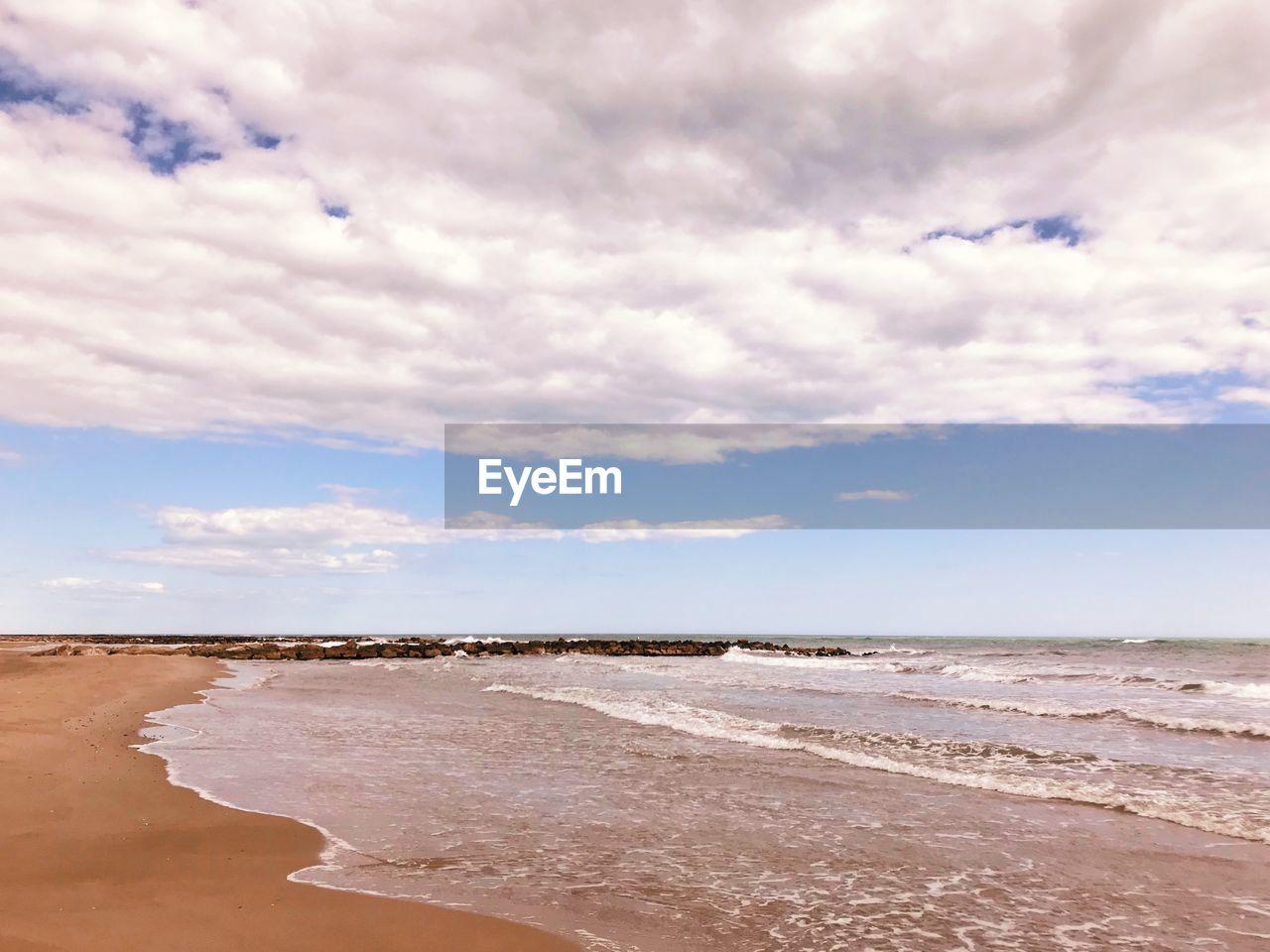 sky, cloud - sky, sea, water, land, beach, beauty in nature, scenics - nature, horizon, tranquility, tranquil scene, nature, horizon over water, day, no people, sand, non-urban scene, sport, outdoors, salt flat