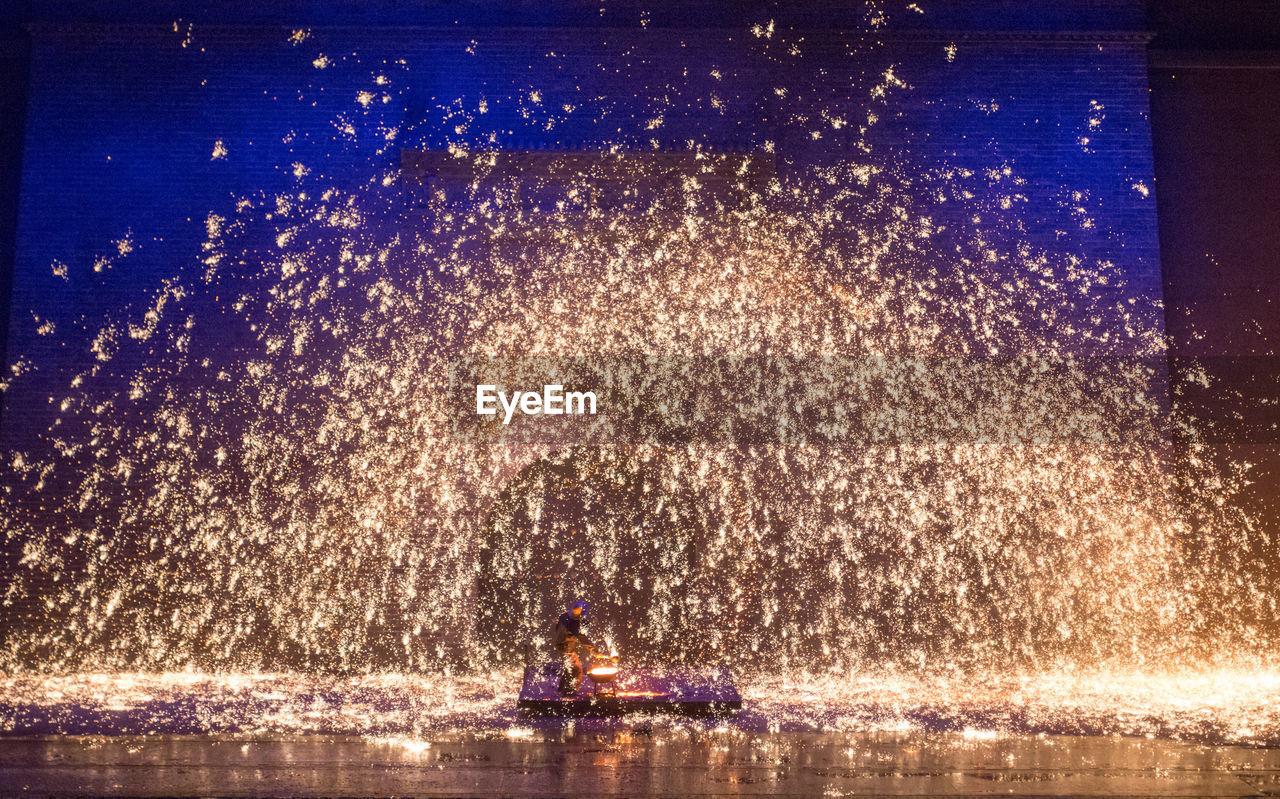 VIEW OF FIREWORK DISPLAY AT NIGHT
