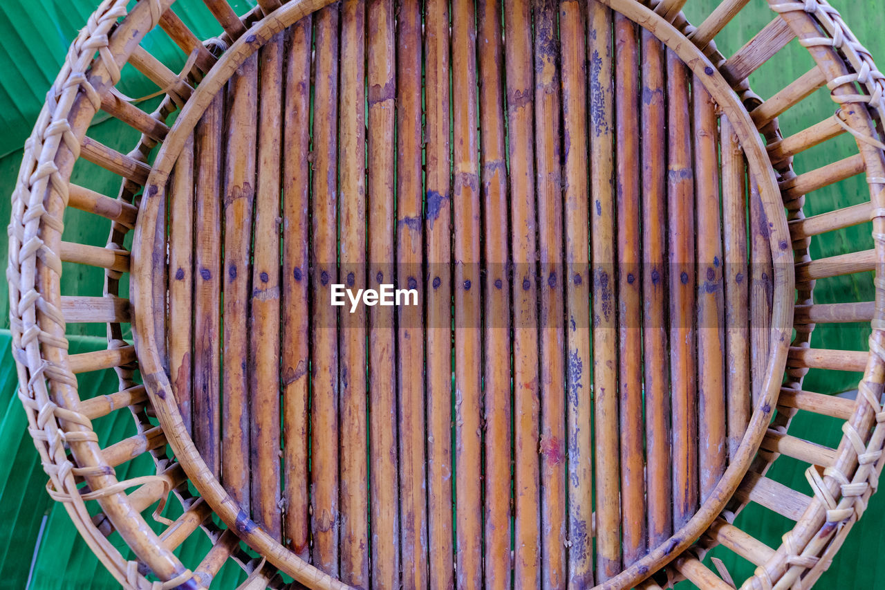 pattern, no people, metal, container, close-up, day, large group of objects, old, rusty, cylinder, basket, high angle view, wood - material, directly above, backgrounds, shape, nature, design, circle, still life
