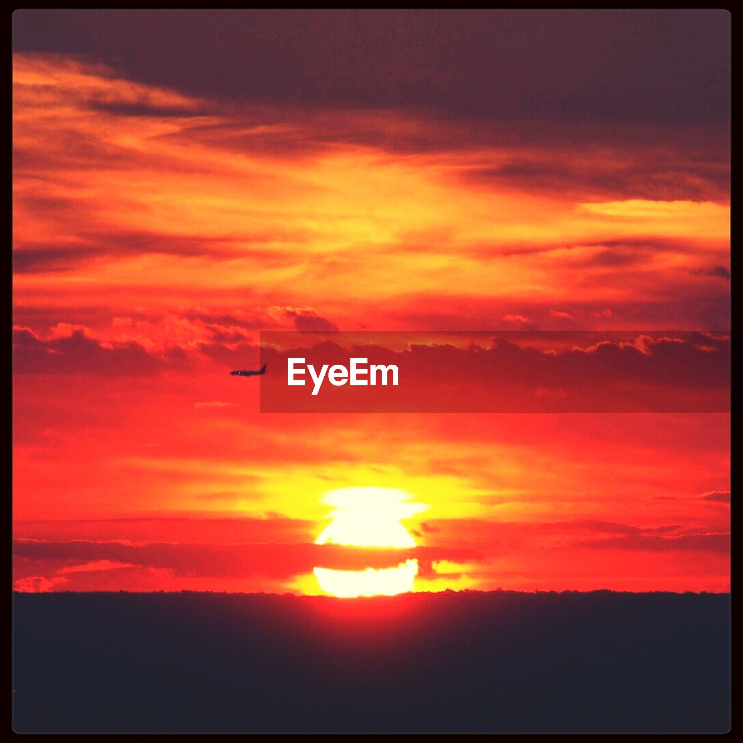 Fiery sunset over silhouette landscape