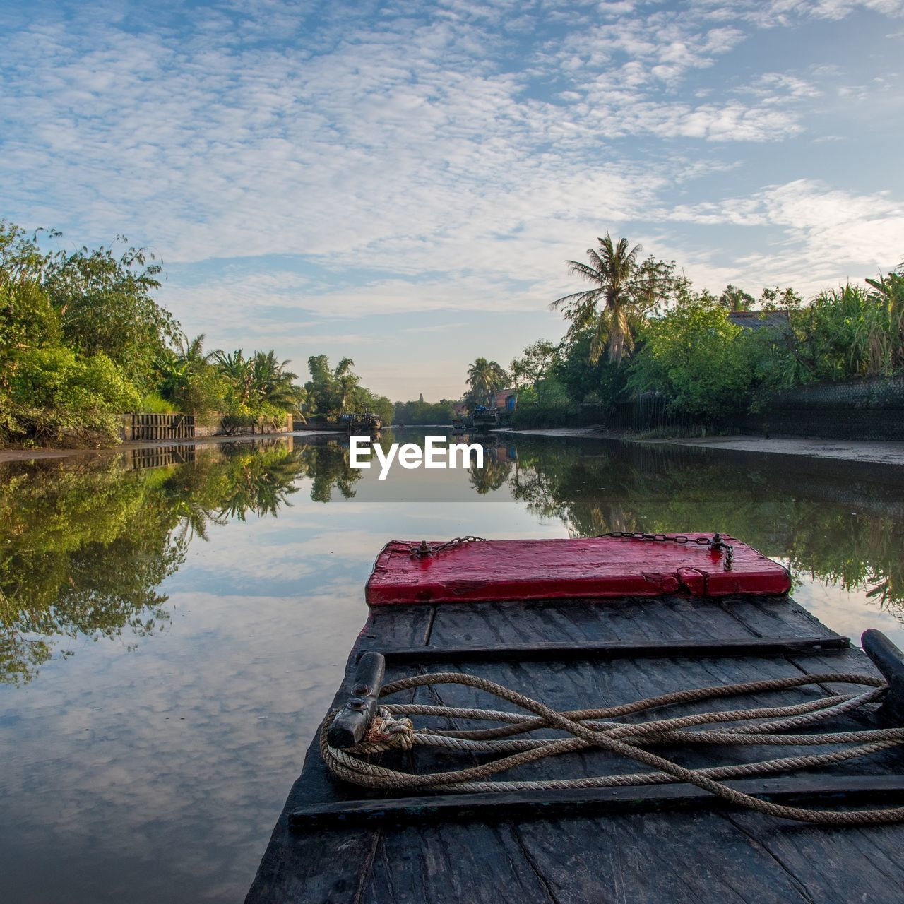 water, nautical vessel, lake, transportation, tree, boat, nature, no people, reflection, moored, mode of transport, outdoors, day, tranquility, tranquil scene, sky, cloud - sky, wooden raft, beauty in nature, scenics, oar