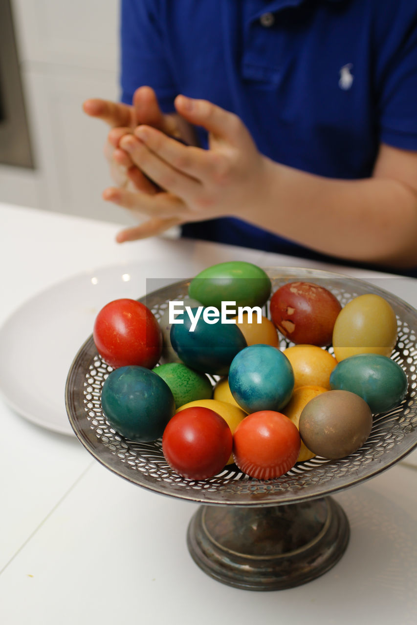 High Angle View Of Multi Colored Easter Eggs On Table