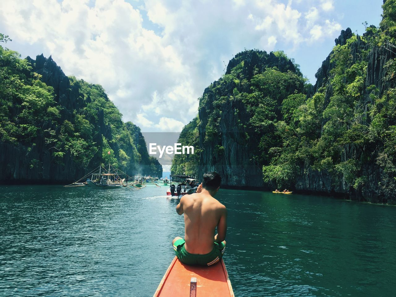 water, tree, real people, sky, plant, rear view, nature, cloud - sky, day, lifestyles, shirtless, one person, beauty in nature, leisure activity, transportation, men, nautical vessel, three quarter length, scenics - nature, outdoors