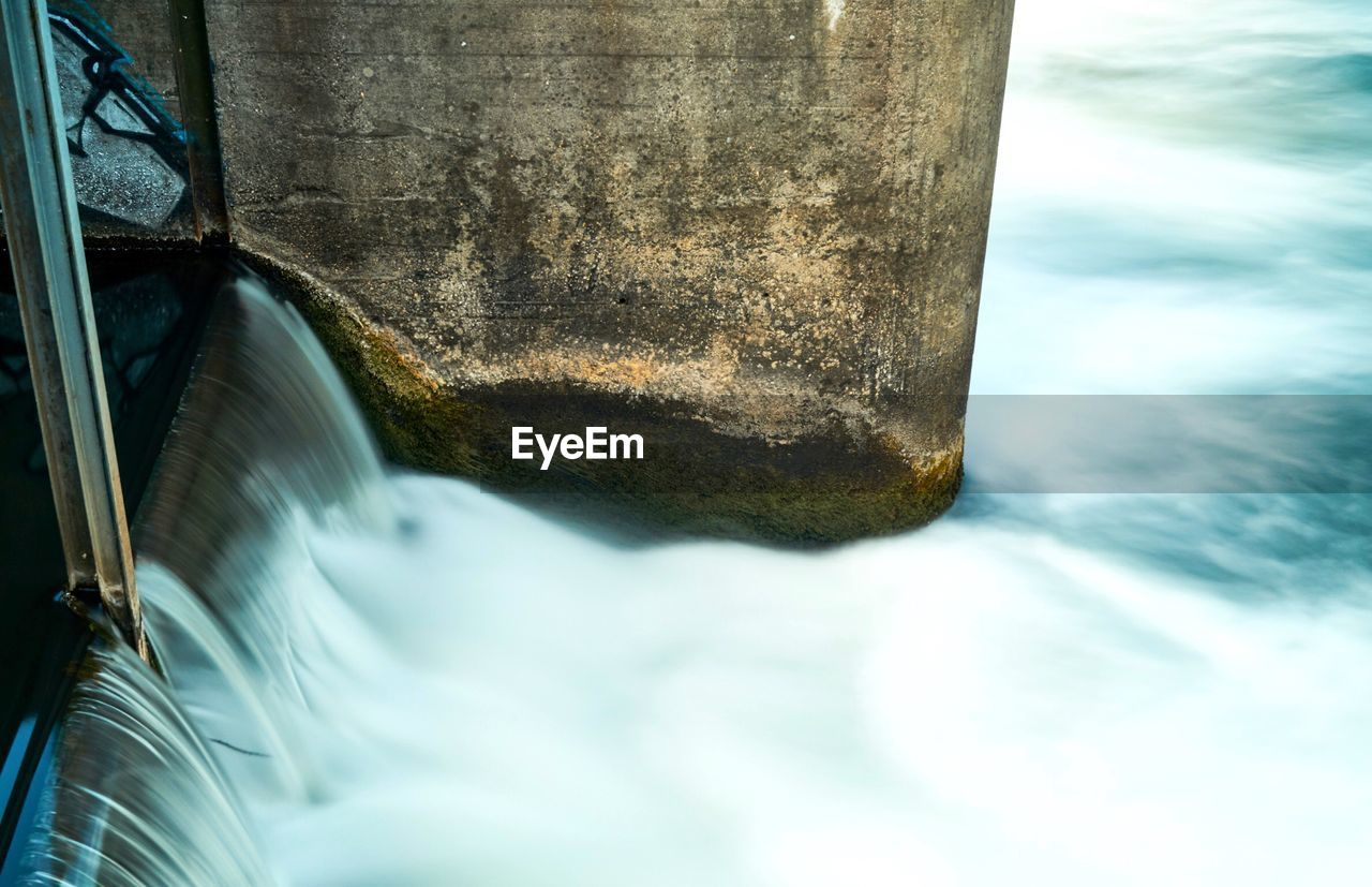 water, no people, day, nature, metal, close-up, motion, built structure, architecture, connection, outdoors, bridge, bridge - man made structure, transportation, river, solid, blurred motion, flowing water, flowing, concrete