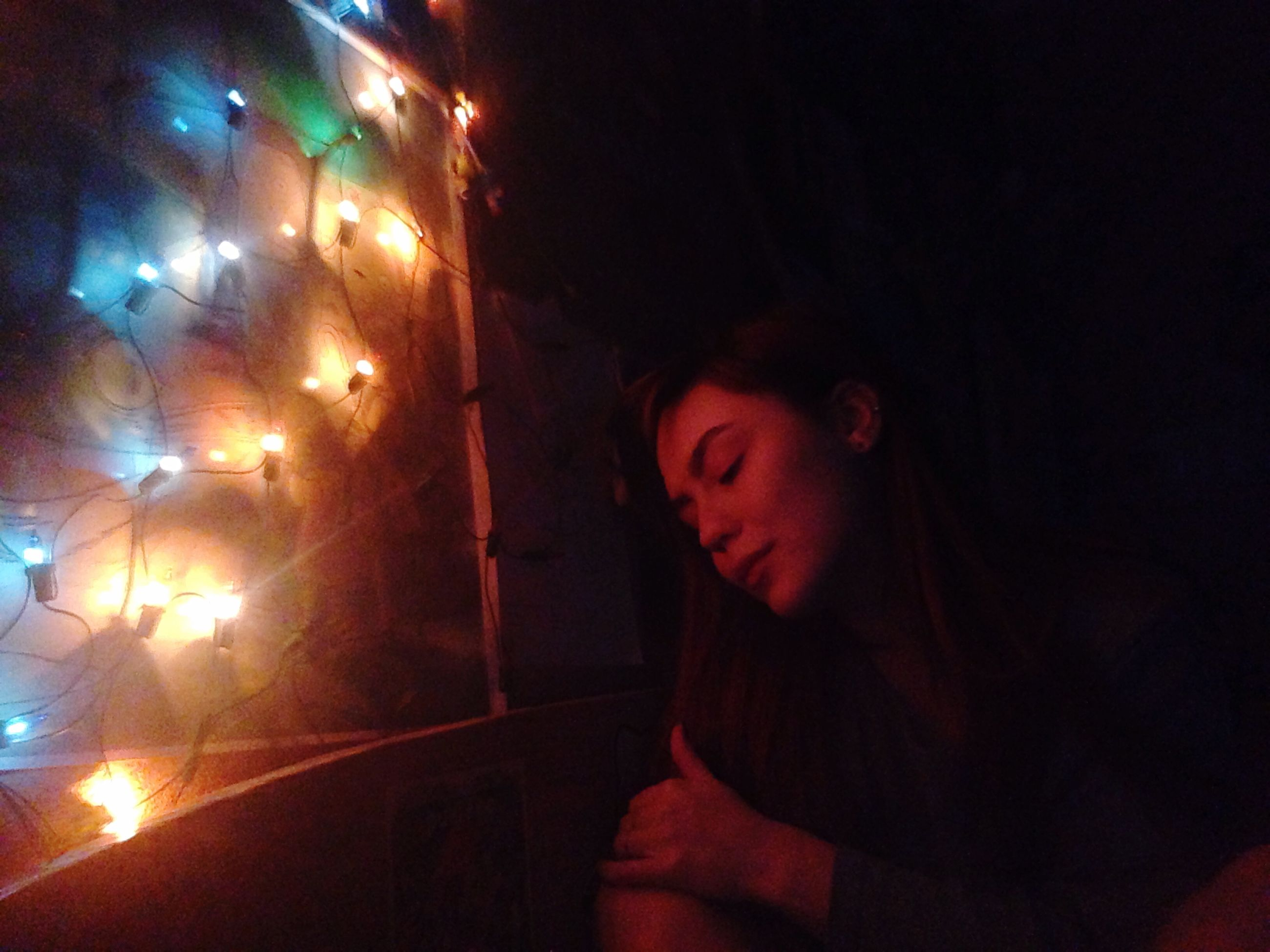 night, illuminated, indoors, real people, one person, lifestyles, leisure activity, young adult, young women, close-up, people