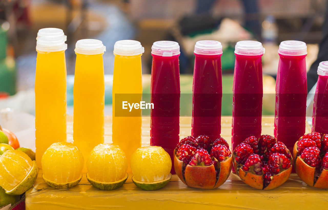 food and drink, food, fruit, freshness, healthy eating, still life, focus on foreground, wellbeing, container, table, close-up, red, indoors, choice, glass - material, refreshment, drink, yellow, variation, no people, glass