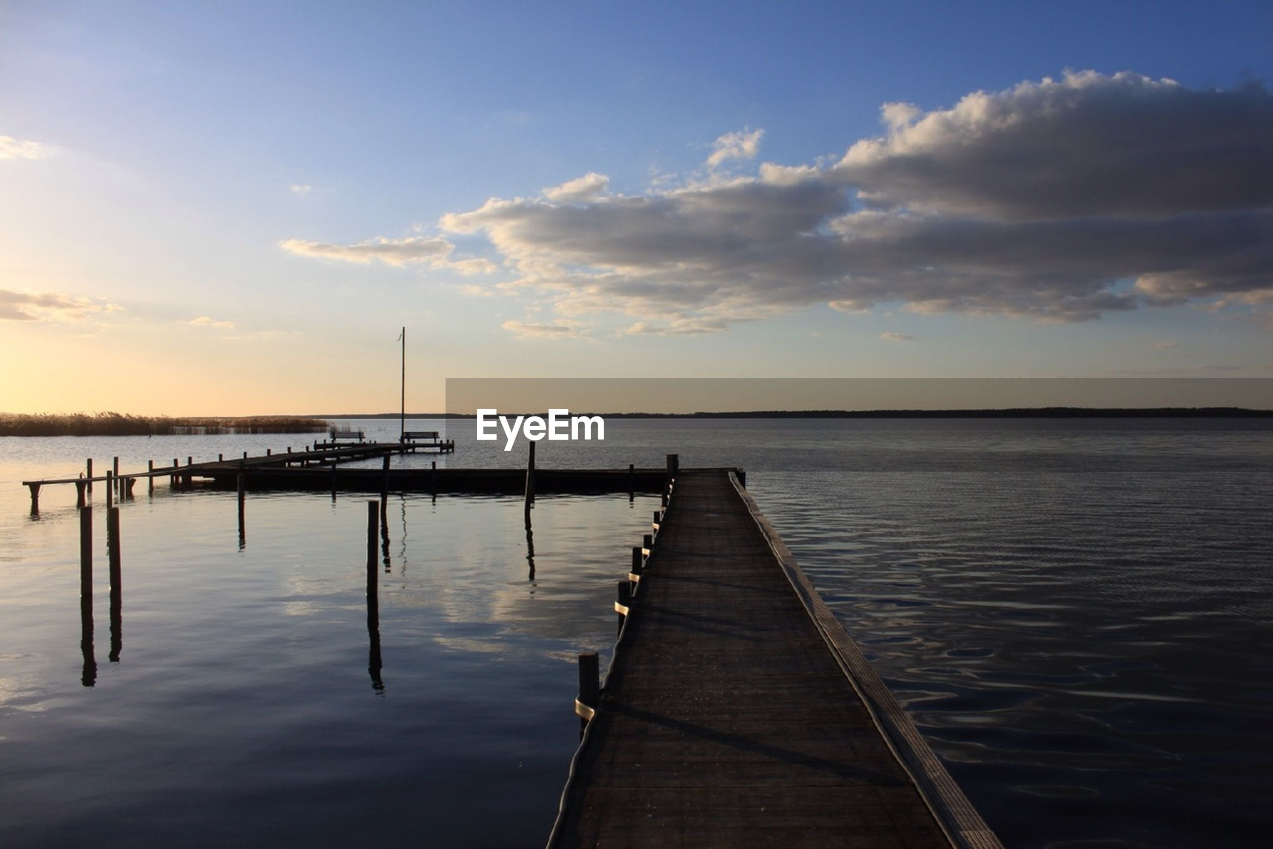 water, sunset, sky, pier, sea, tranquil scene, tranquility, scenics, beauty in nature, cloud - sky, jetty, nature, horizon over water, cloud, idyllic, reflection, wood - material, the way forward, transportation, outdoors
