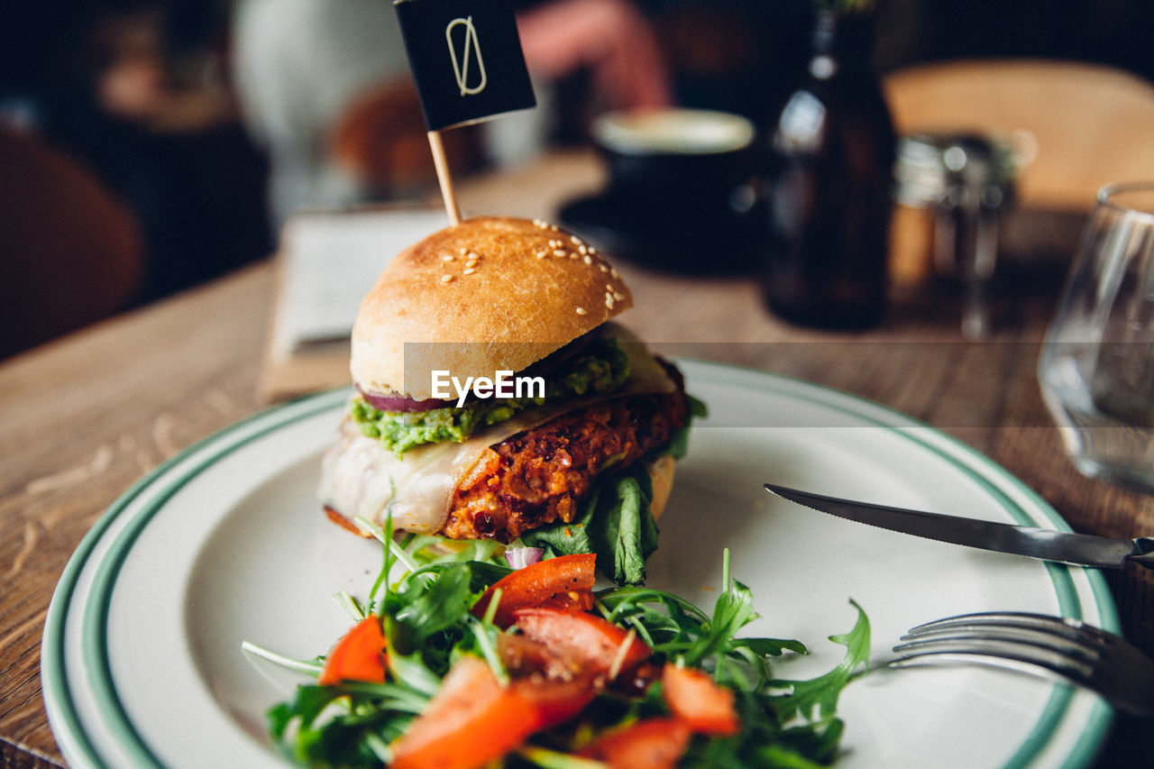 food and drink, table, food, plate, indoors, hamburger, ready-to-eat, burger, fork, vegetable, tomato, freshness, close-up, no people, day