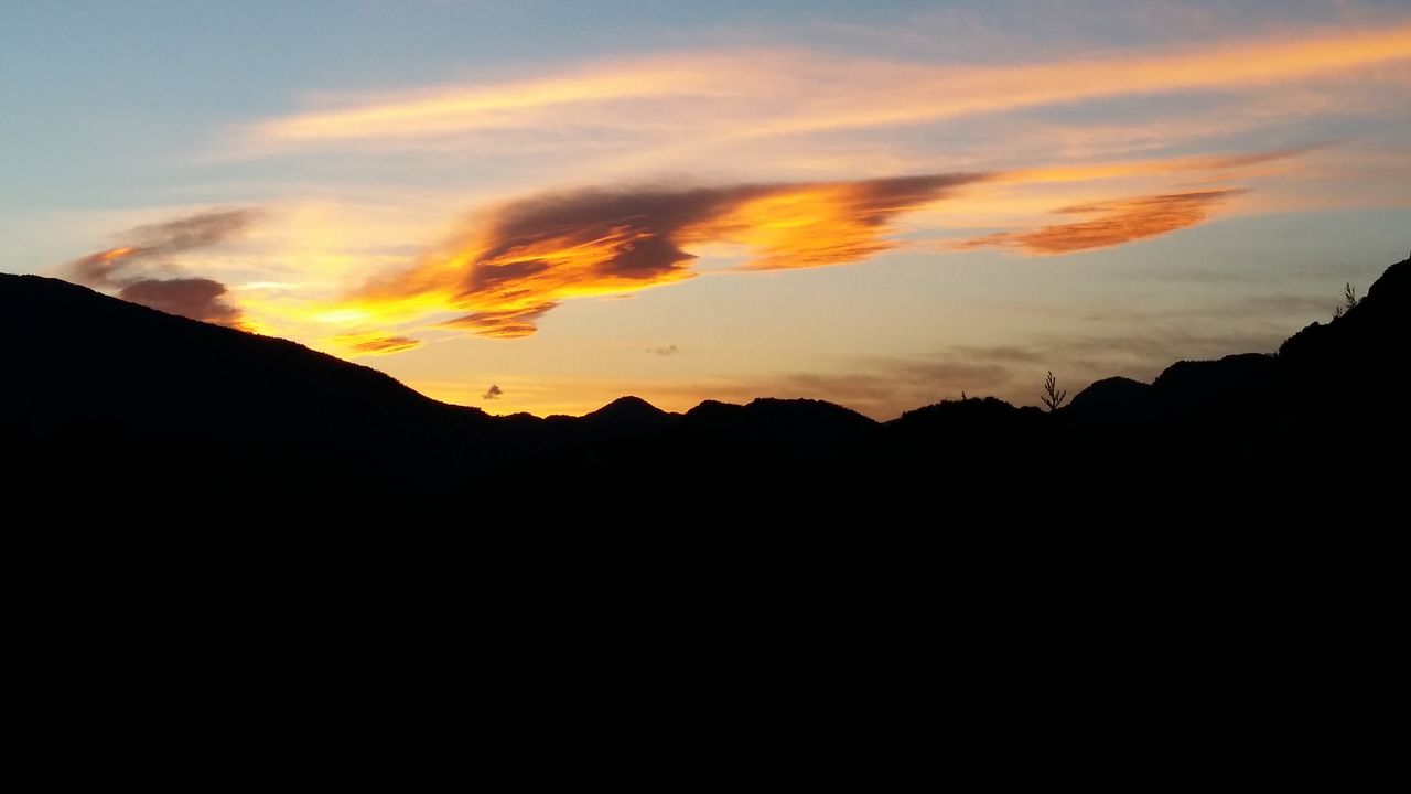 sunset, beauty in nature, silhouette, scenics, sky, mountain, tranquil scene, nature, tranquility, cloud - sky, dramatic sky, no people, mountain range, outdoors, low angle view, landscape, day