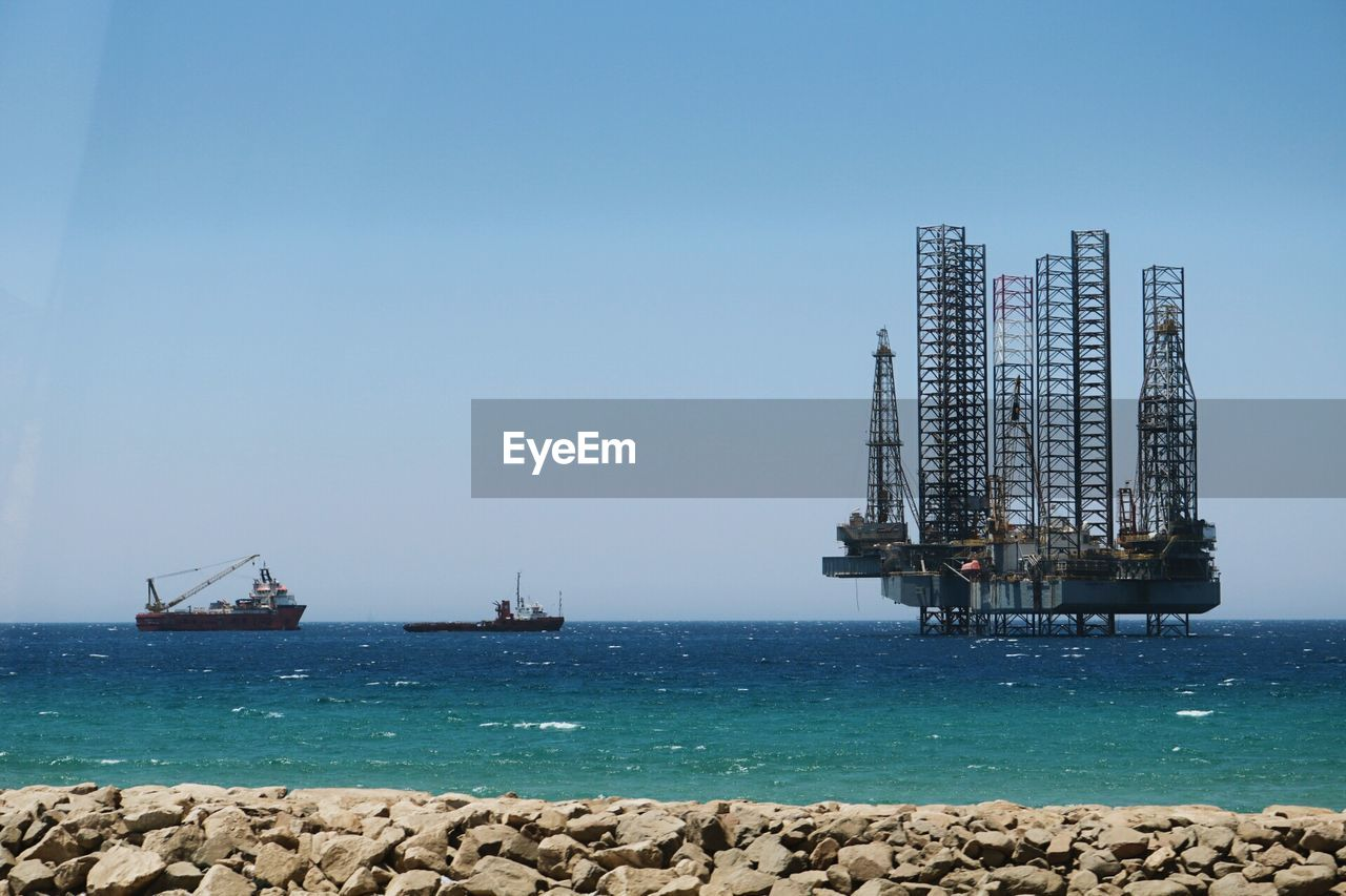 Oil Rig In Sea Against Clear Sky