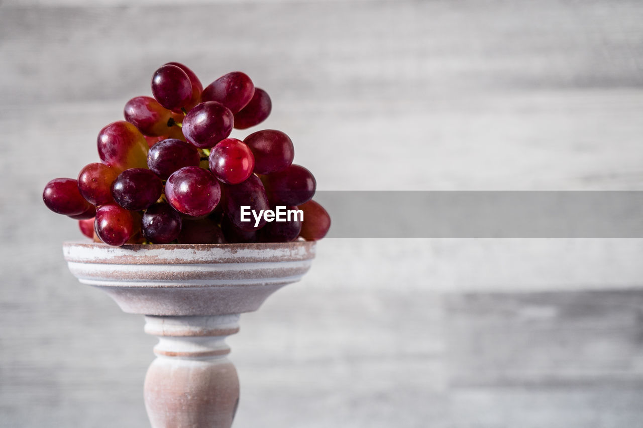 Close-Up Of Grapes On Table