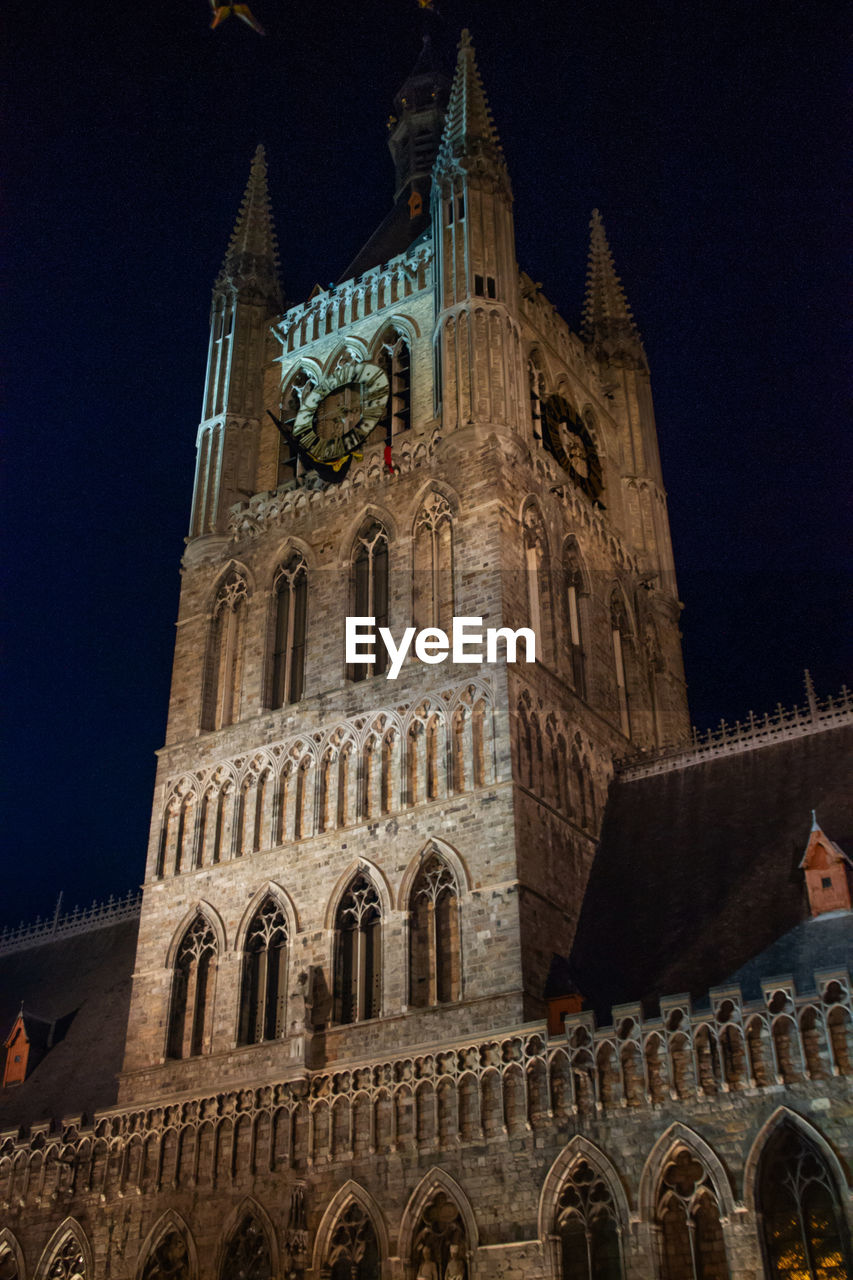 architecture, built structure, building exterior, low angle view, building, sky, the past, history, belief, travel destinations, religion, place of worship, night, travel, tower, tourism, spirituality, city, no people, outdoors, gothic style, spire
