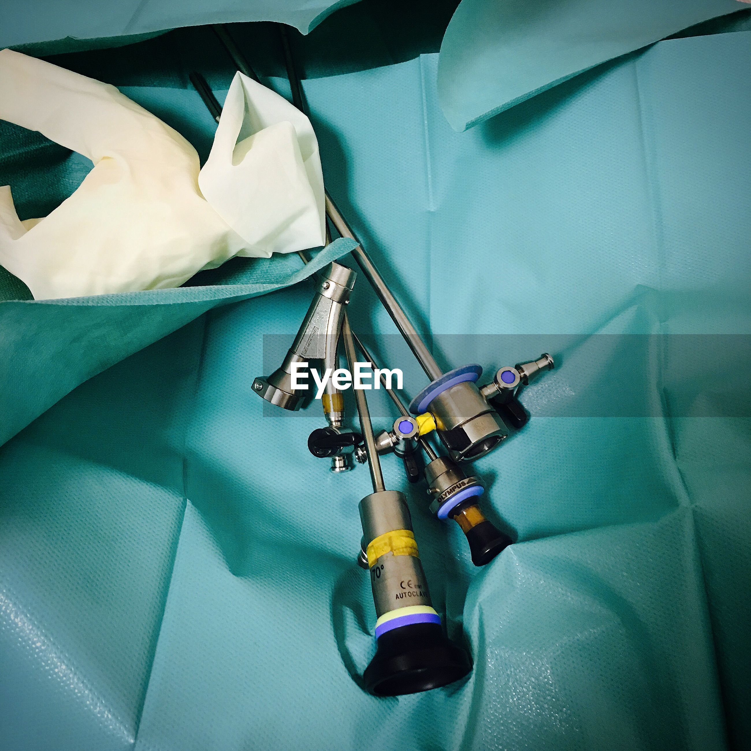 High angle view of medical equipment on textile