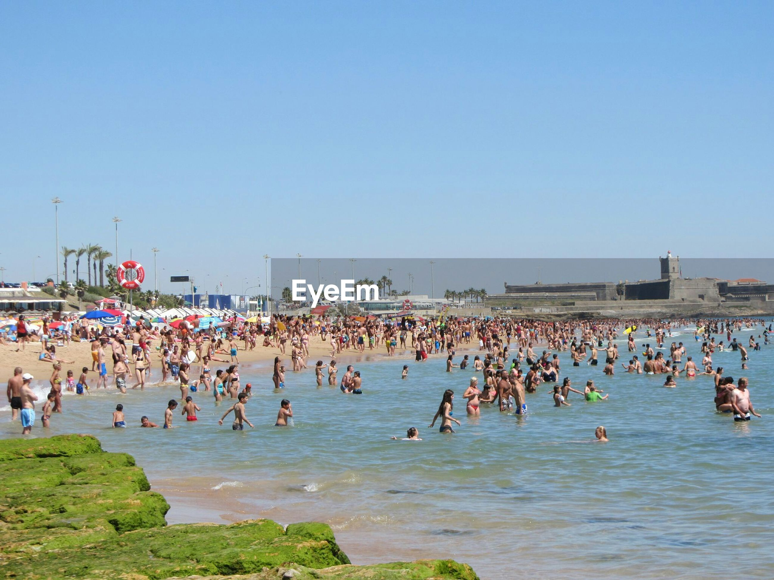 Crowded beach on sunny day