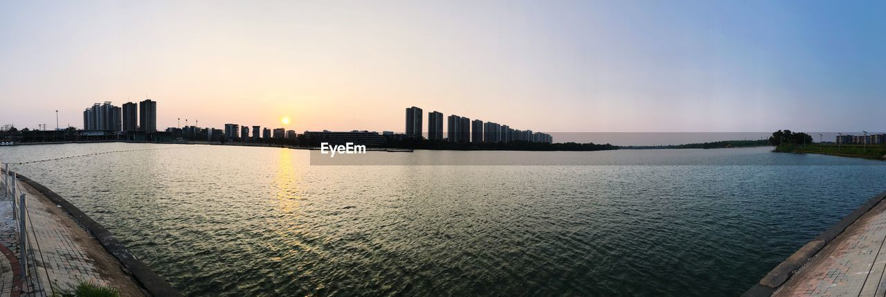 SCENIC VIEW OF CITY AT SUNSET