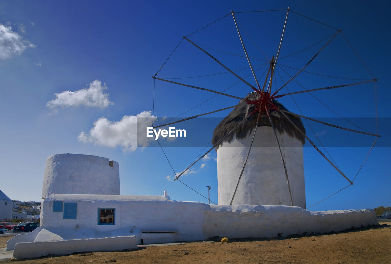 sky, fuel and power generation, alternative energy, renewable energy, wind power, wind turbine, environmental conservation, turbine, environment, nature, day, land, cloud - sky, architecture, built structure, traditional windmill, blue, landscape, low angle view, no people, outdoors