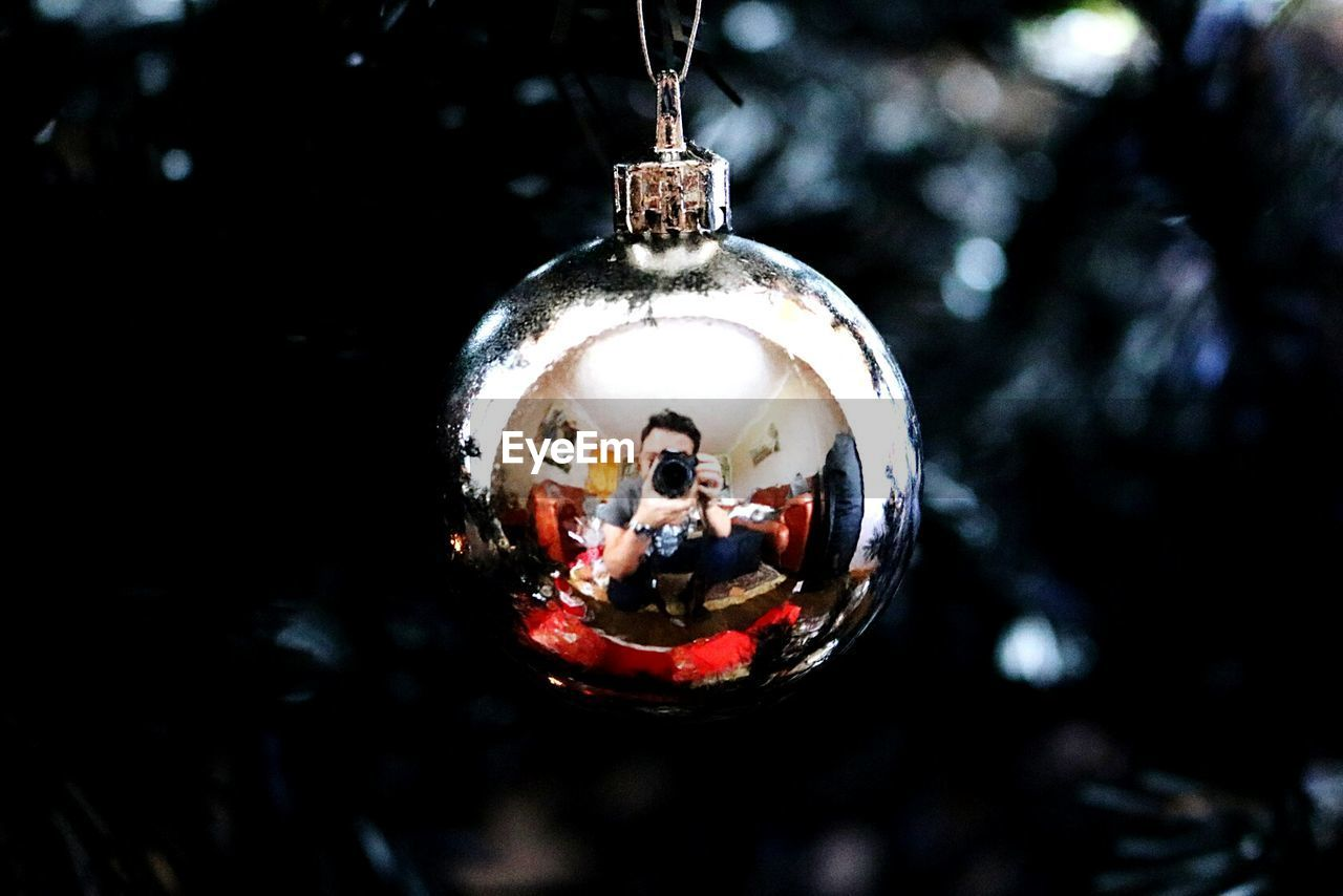 hanging, close-up, no people, christmas decoration, outdoors, bauble, day