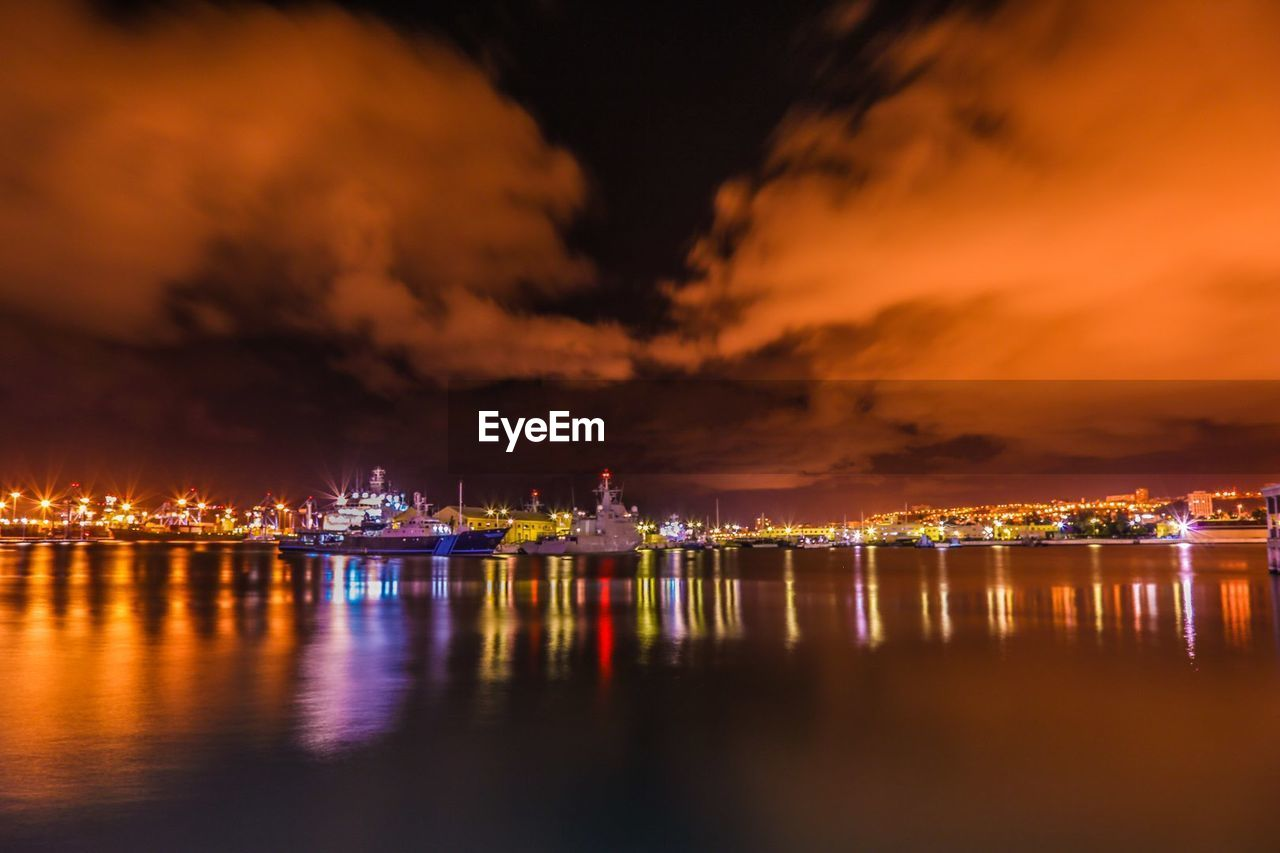 sky, water, cloud - sky, night, reflection, illuminated, waterfront, architecture, building exterior, city, nature, built structure, no people, sea, transportation, cityscape, nautical vessel, orange color, outdoors, light