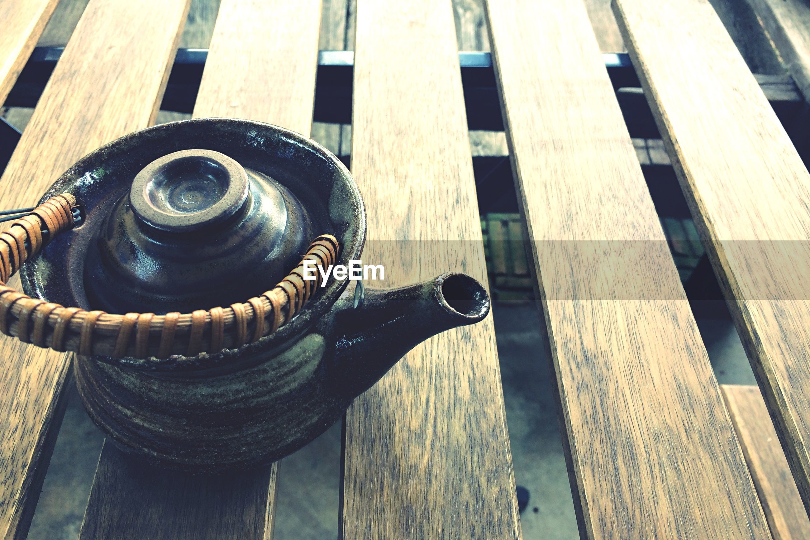 High angle view of kettle on wooden table