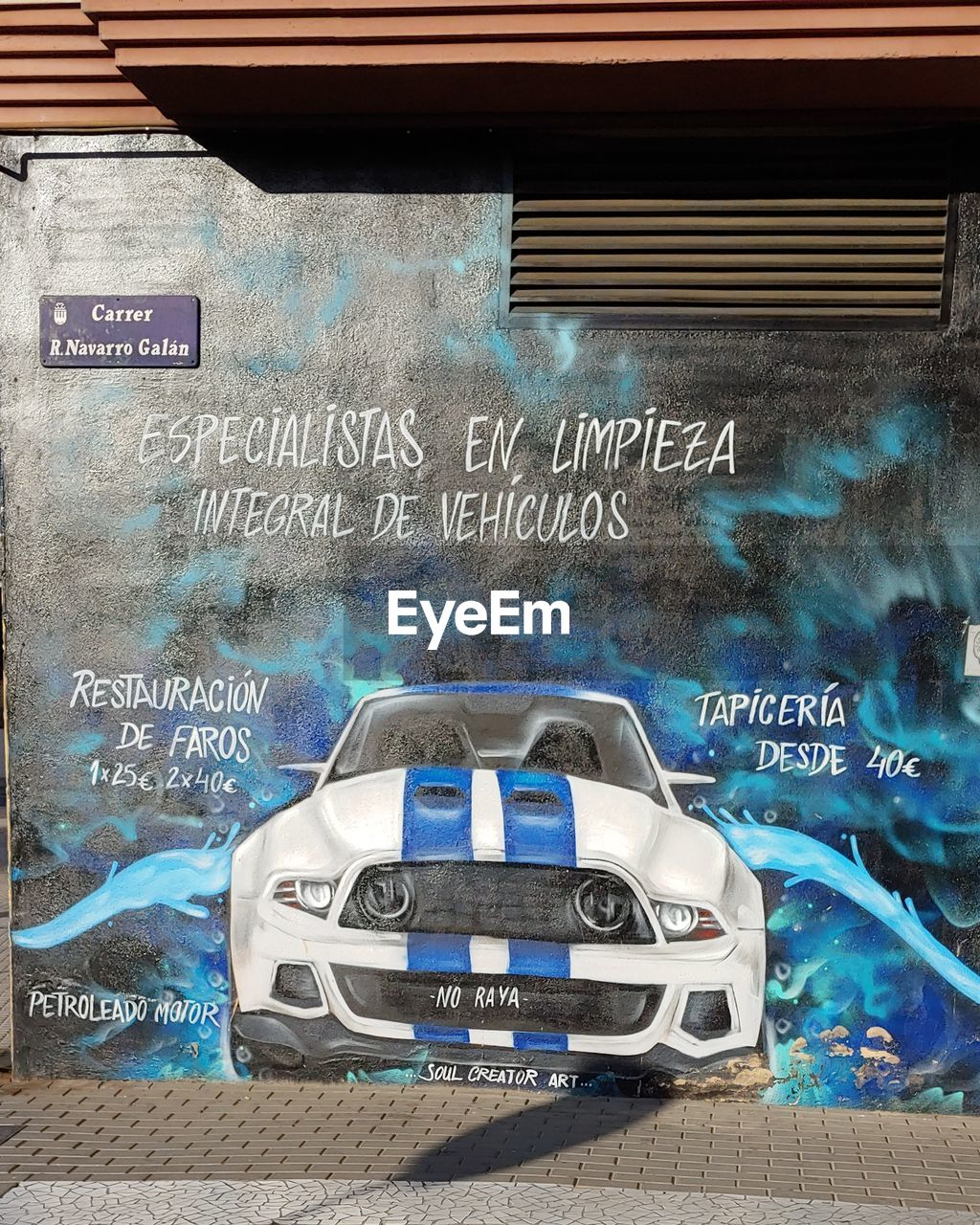 text, western script, communication, no people, architecture, car, mode of transportation, blue, indoors, number, motor vehicle, day, built structure, close-up, nature, graffiti, transportation, technology, building