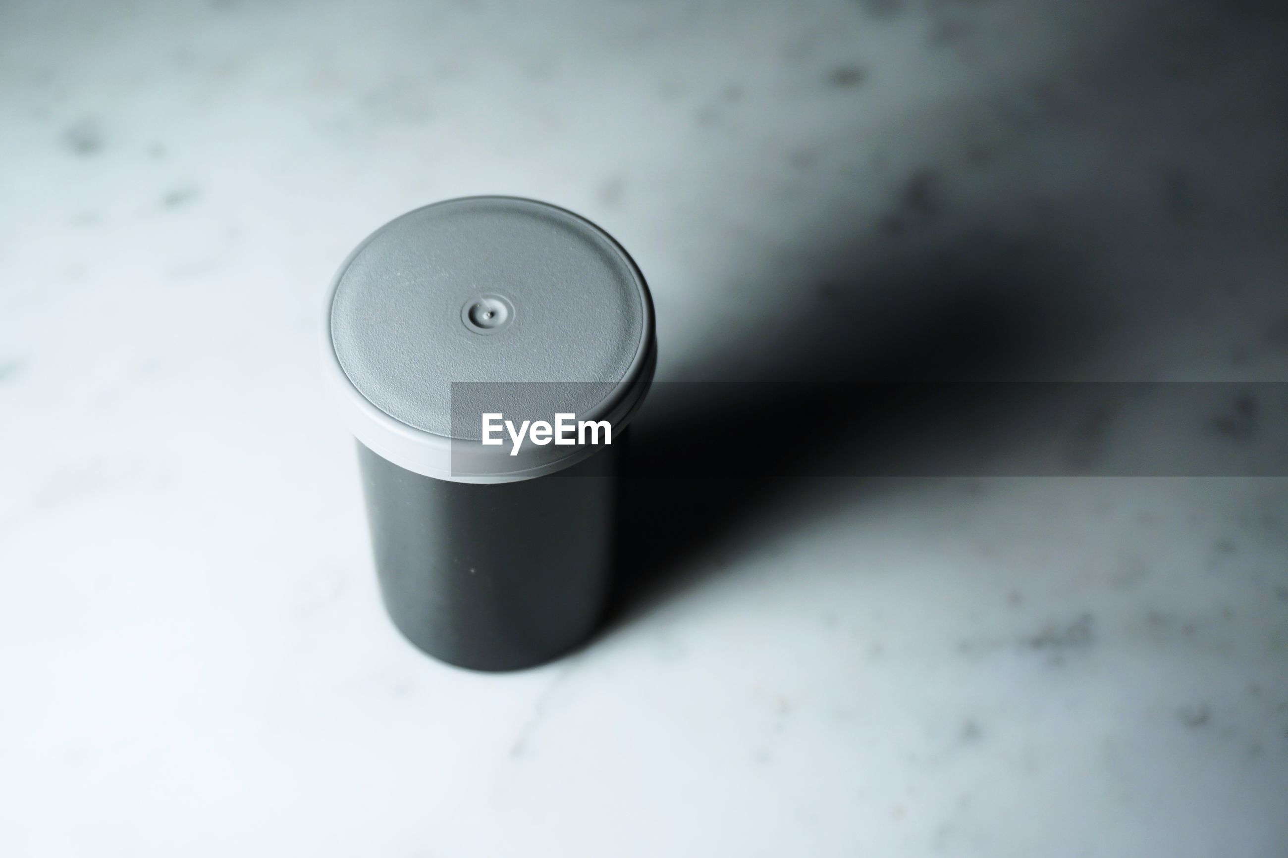 High angle view of black container on table