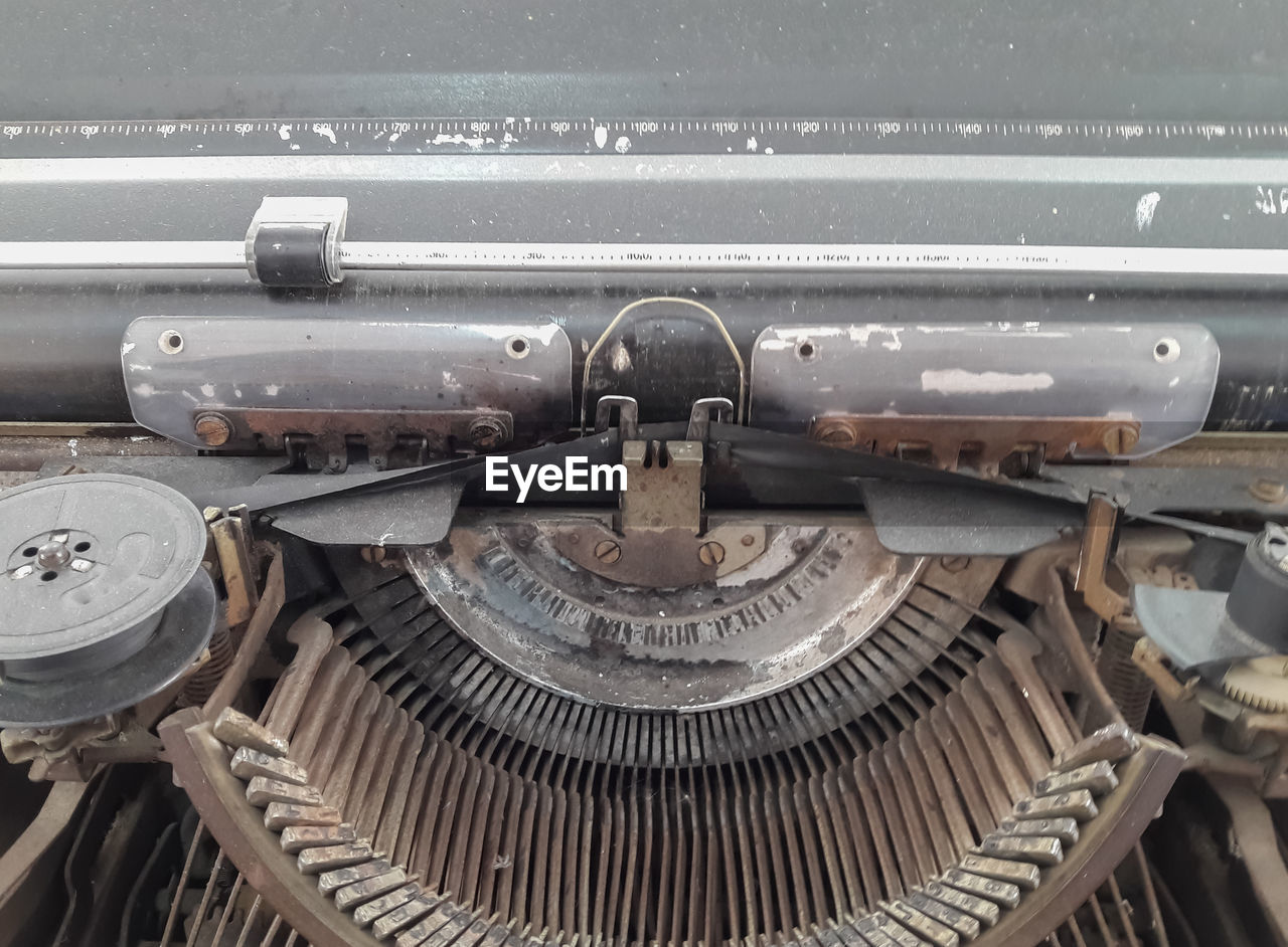 metal, old-fashioned, text, obsolete, retro styled, history, close-up, antique, weapon, backgrounds, typewriter, technology, no people, day, outdoors