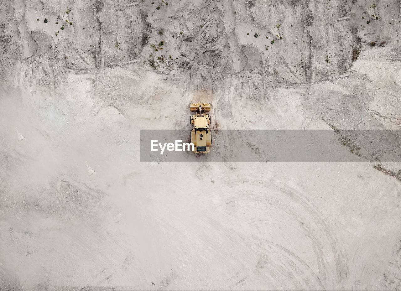 Aerial view of bulldozer on sand