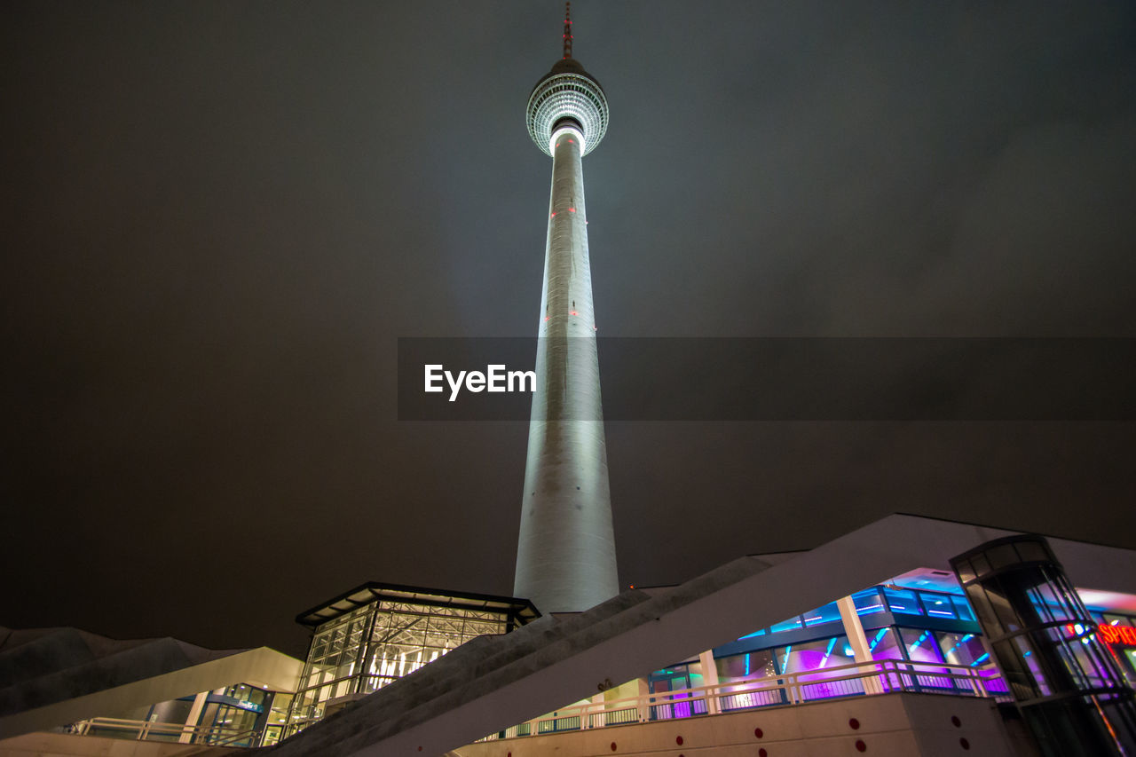 architecture, built structure, tall - high, low angle view, travel destinations, tower, building exterior, tourism, communication, travel, sky, outdoors, city, night, illuminated, no people, skyscraper