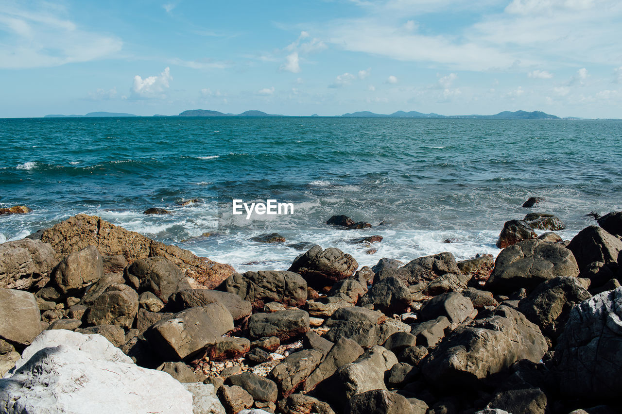 sea, water, nature, rock - object, beauty in nature, horizon over water, scenics, sky, outdoors, beach, day, no people, cloud - sky, wave