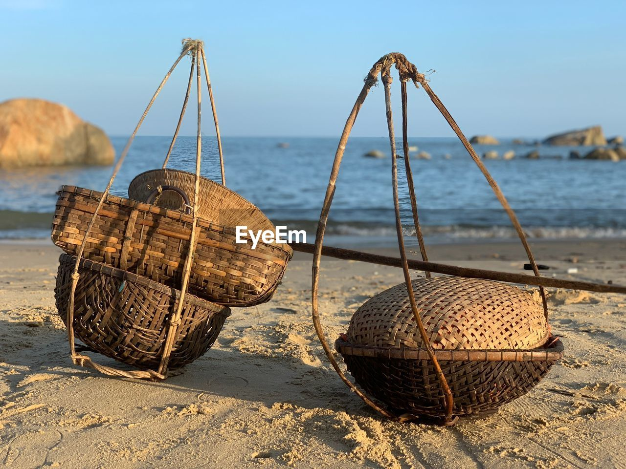 nature, basket, focus on foreground, beach, container, land, sea, sunlight, day, no people, sand, water, sky, outdoors, rusty, close-up, brown, transportation, food and drink