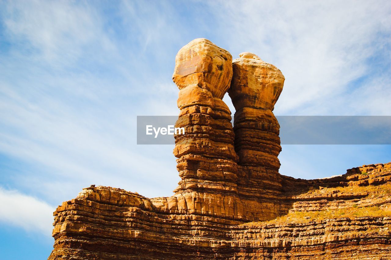 Low angle view of twin rocks against sky at utah