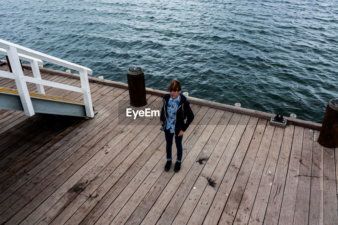 High Angle View Of Teenager Standing At Busselton Jetty