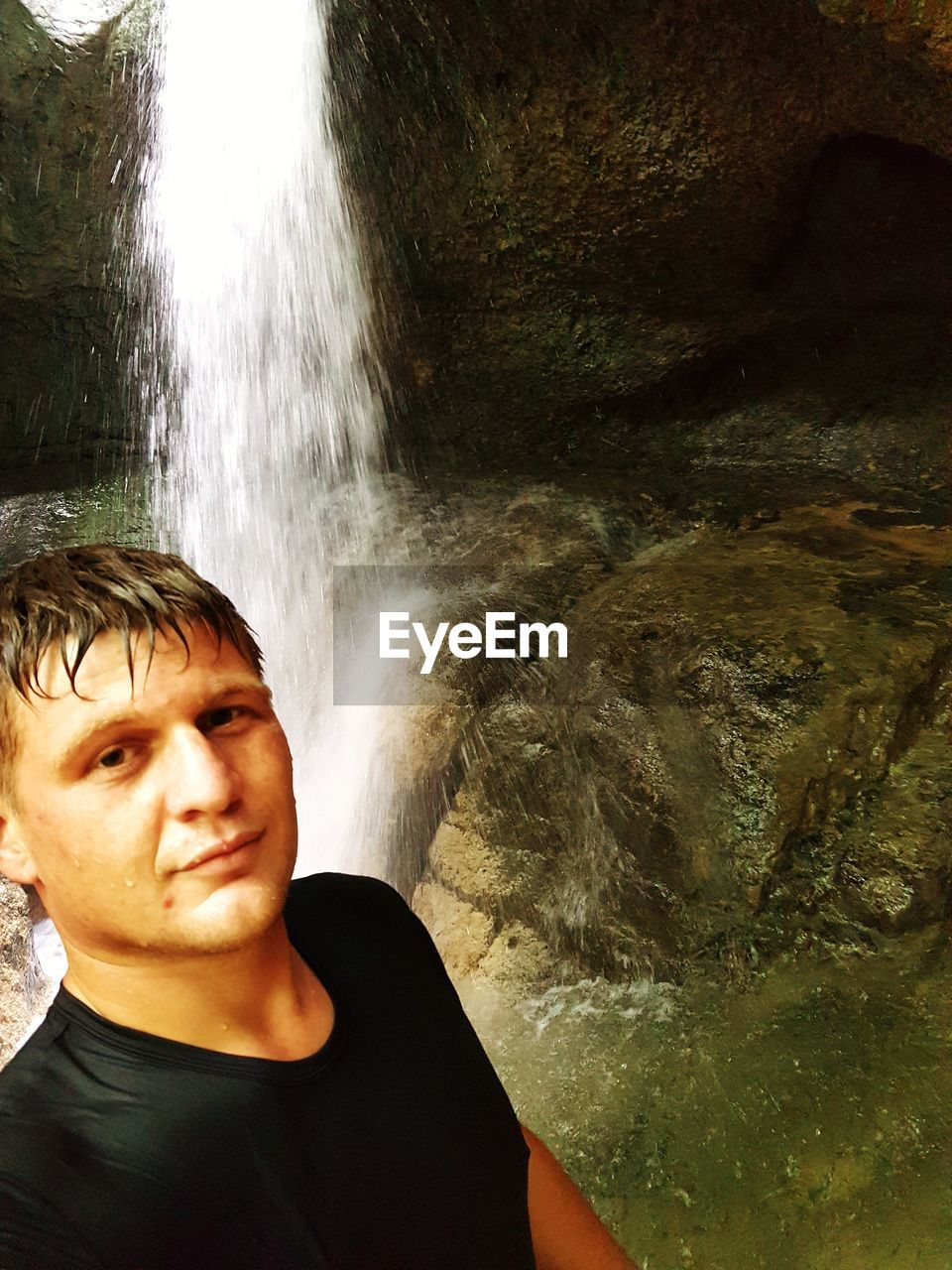 one person, water, real people, waterfall, lifestyles, leisure activity, portrait, motion, headshot, young adult, nature, flowing water, long exposure, beauty in nature, rock, young men, scenics - nature, day, flowing, outdoors, power in nature